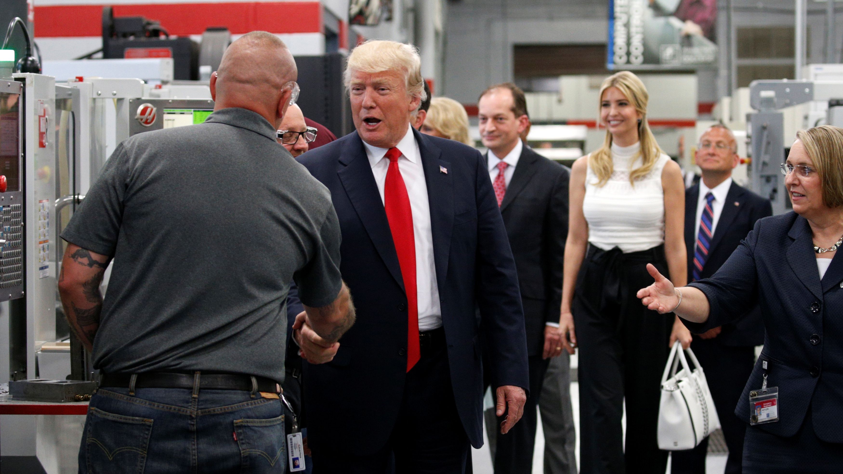 U.S. President Donald Trump shakes hands as he tours Waukesha County Technical College with his daughter Ivanka in Pewaukee, Wisconsin, U.S., June 13, 2017. REUTERS/Kevin Lamarque