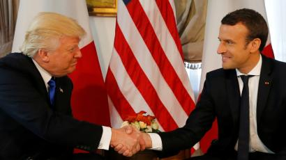 French president Emmanuel Macron shakes hands with US President Donald Trump