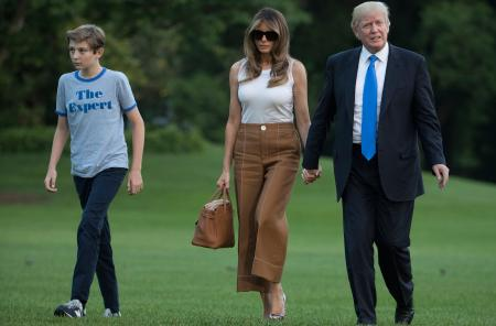 President Donald Trump, first lady Melania Trump, and their son and Barron Trump walk from Marine One across the South Lawn to the White House in Washington, Sunday, June 11, 2017, as they return from Bedminster, N.J. (AP Photo/Carolyn Kaster)