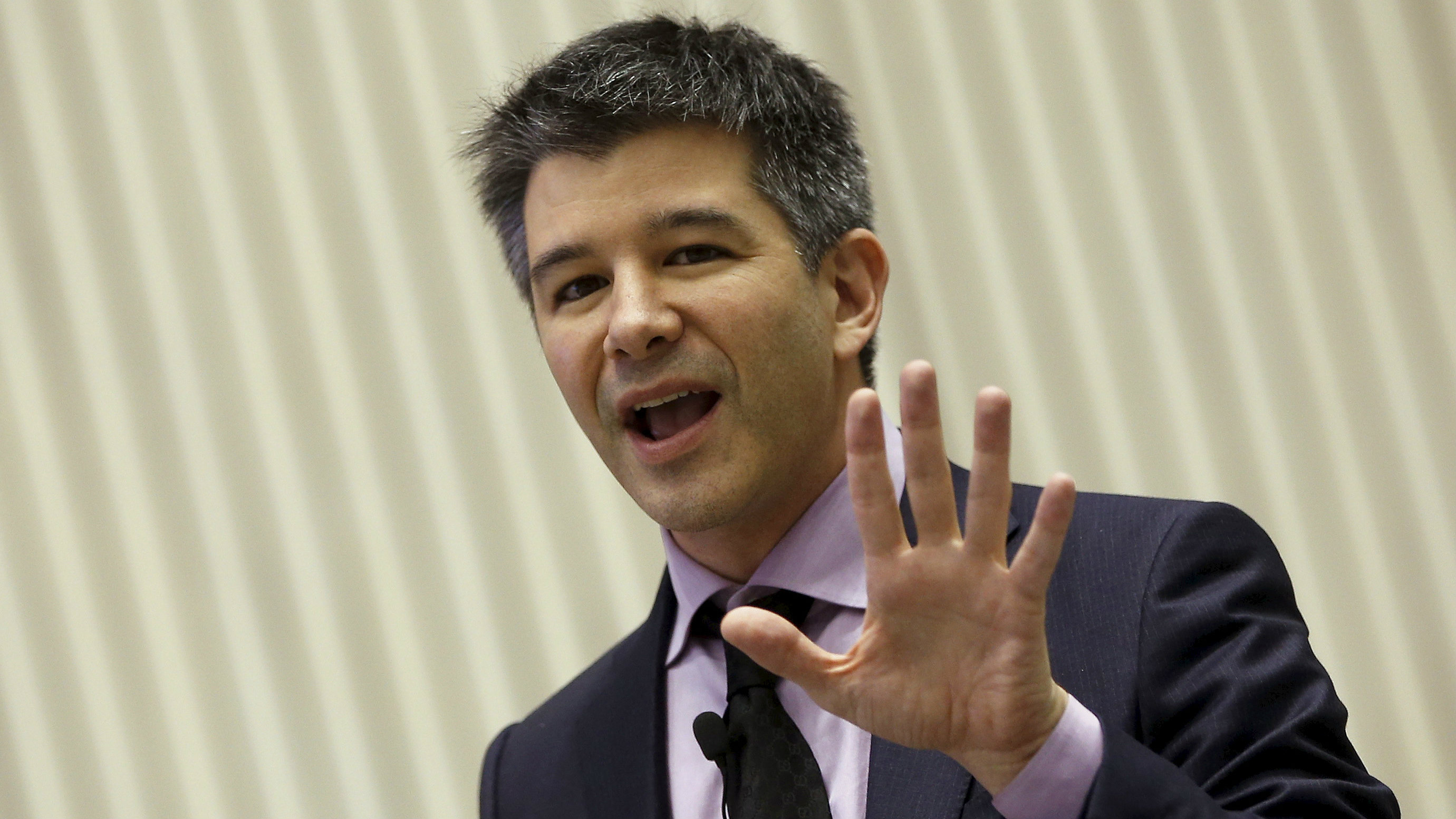 Uber CEO Travis Kalanick gestures as he addresses a gathering during a conference of start-up businesses in New Delhi, India, January 16, 2016.