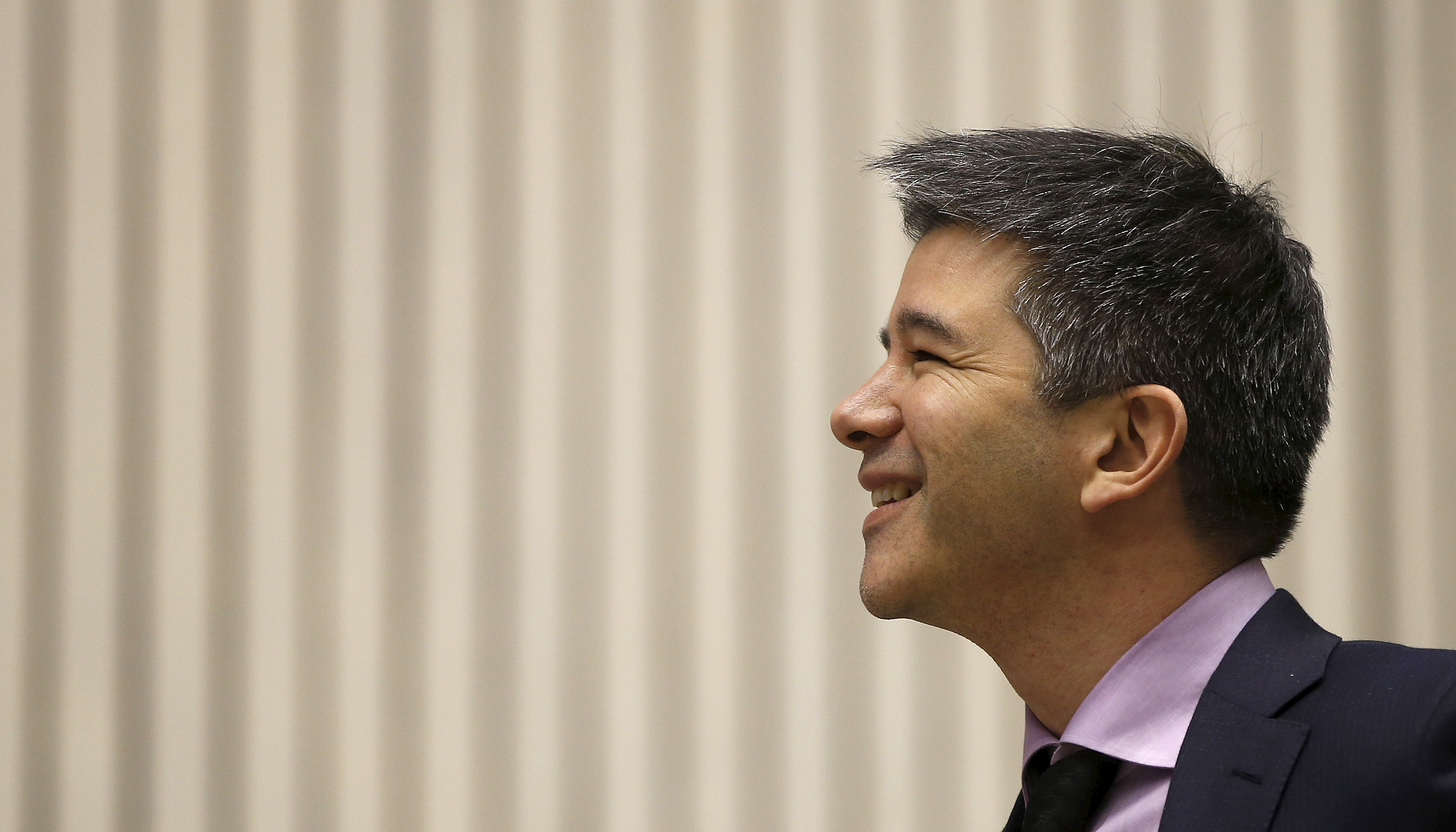 Uber CEO Travis Kalanick smiles as he addresses a gathering during a conference of start-up businesses conference in New Delhi, India,