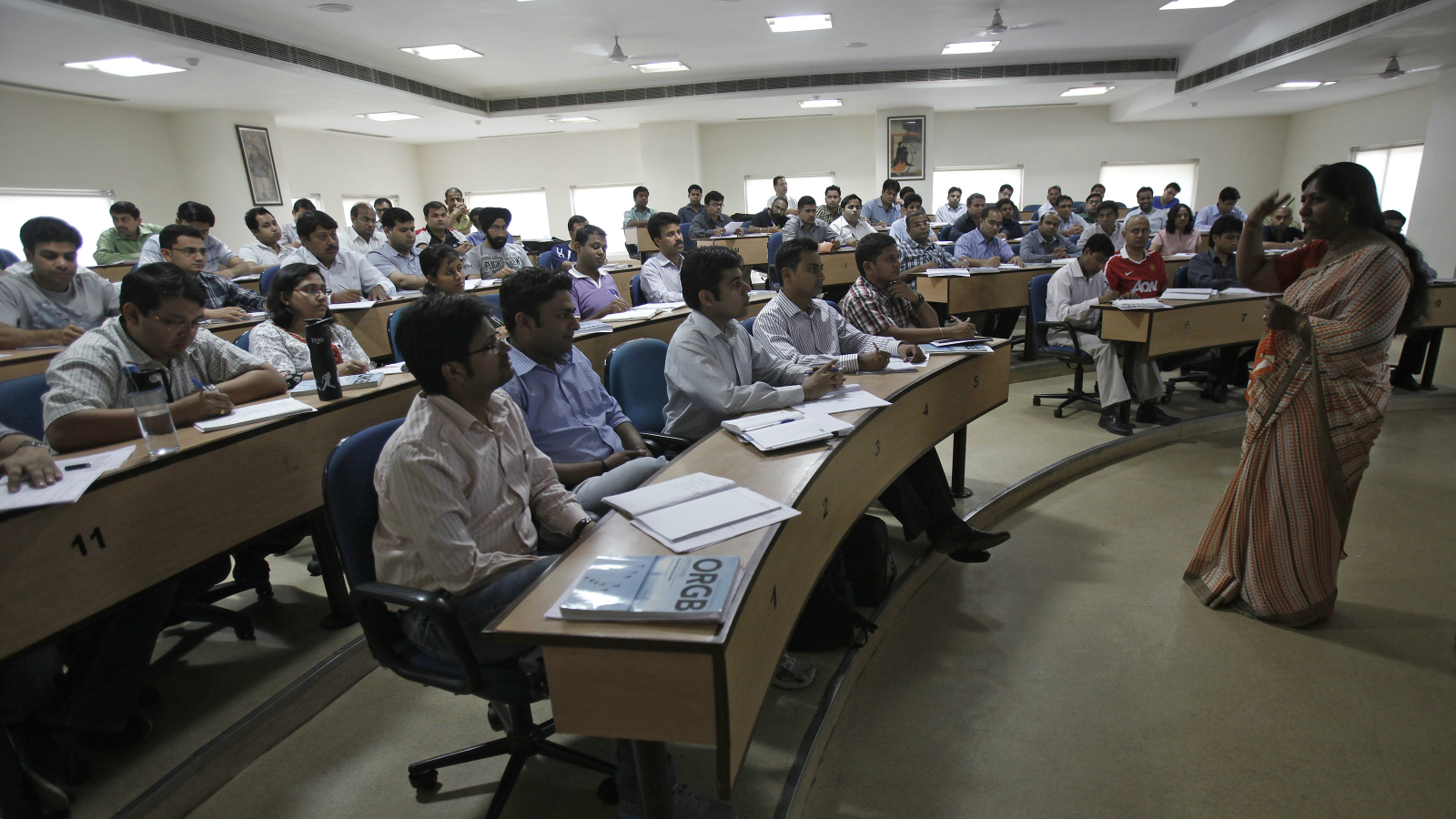 Master of Business Administration (MBA) students attend a lecture at a classroom at the Management Development Institute (MDI) in Gurgaon, on the outskirts of New Delhi May 2, 2012. Fiscal constraints have increased the Indian government's reliance on private education institutes leading to a proliferation of private colleges like MDI. The number of management institutes has more than trebled to around 4000 in the last five years, of which at least two-thirds are estimated to be private colleges. Picture taken May 2, 2012. Master of Business Administration (MBA) students attend a lecture at a classroom at the Management Development Institute (MDI) in Gurgaon, on the outskirts of New Delhi May 2, 2012. Fiscal constraints have increased the Indian government's reliance on private education institutes leading to a proliferation of private colleges like MDI. The number of management institutes has more than trebled to around 4000 in the last five years, of which at least two-thirds are estimated to be private colleges. Picture taken May 2, 2012. REUTERS/Adnan Abidi