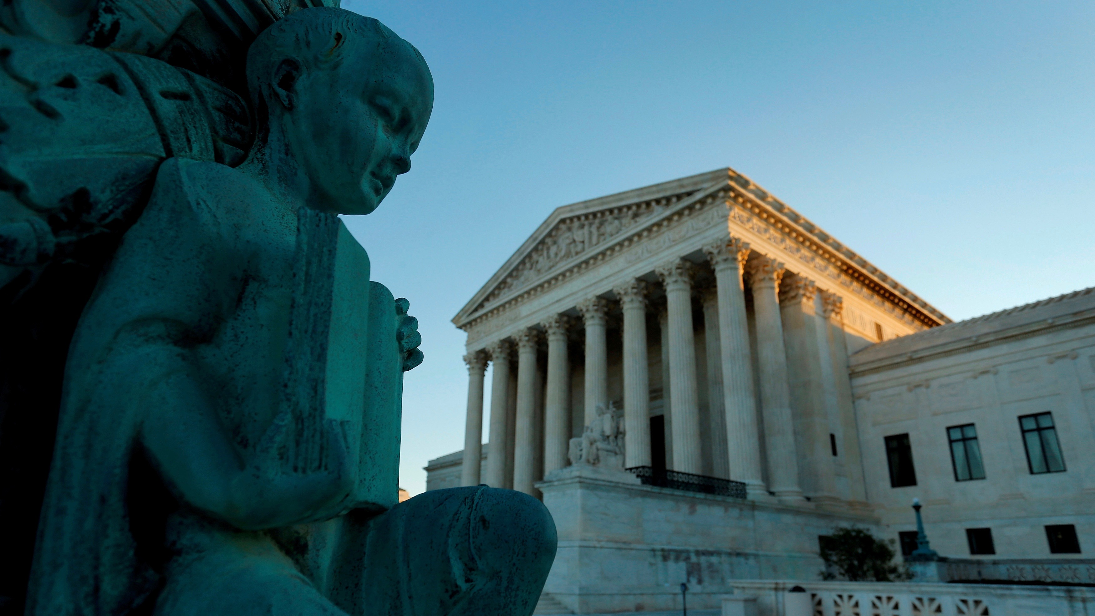 US Supreme Court and nearby statute of child with book.