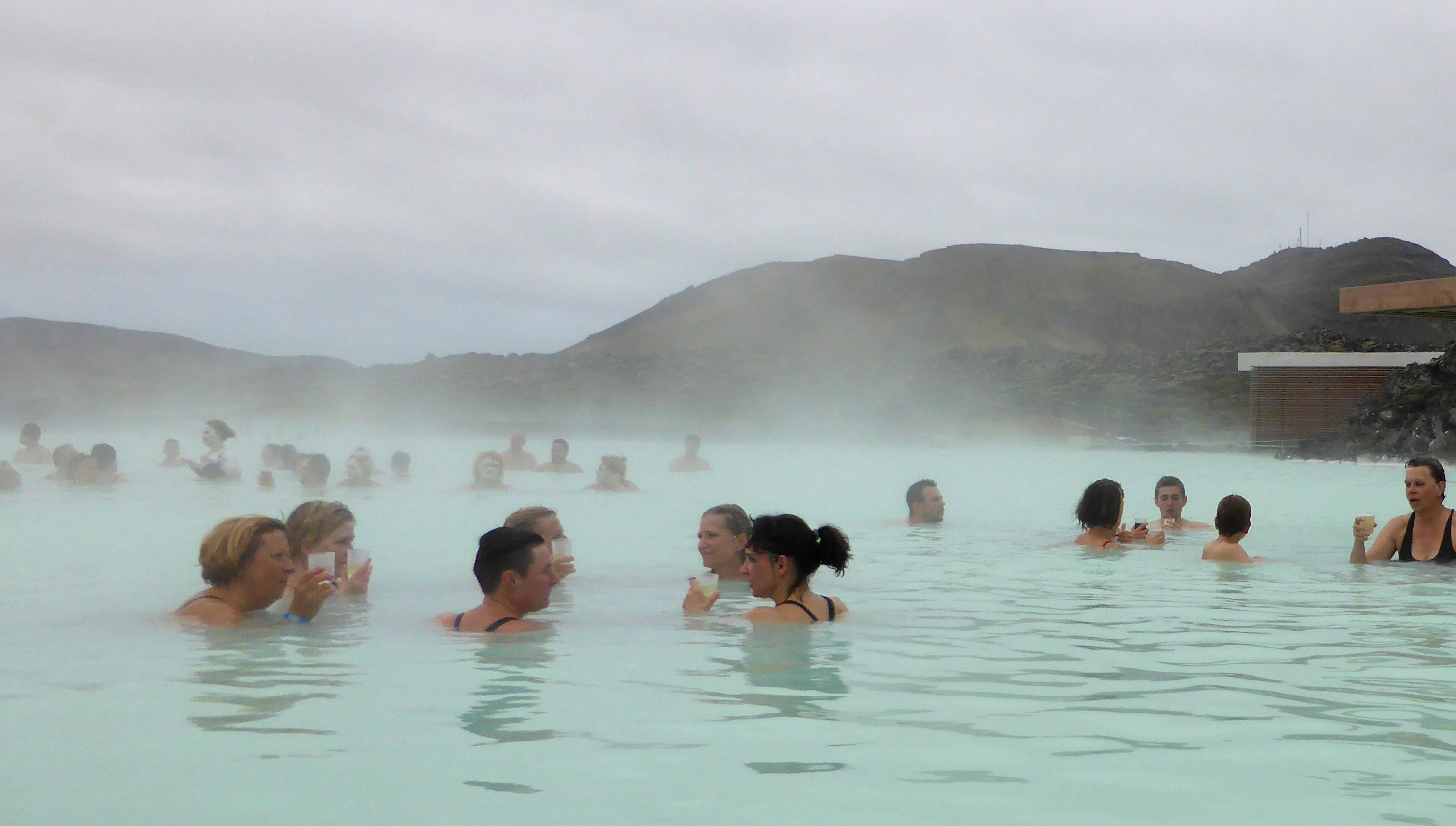 Visitors enjoy a drink in the Blue Lagoon geothermal spa in Grindavik, Iceland, May 25, 2016.