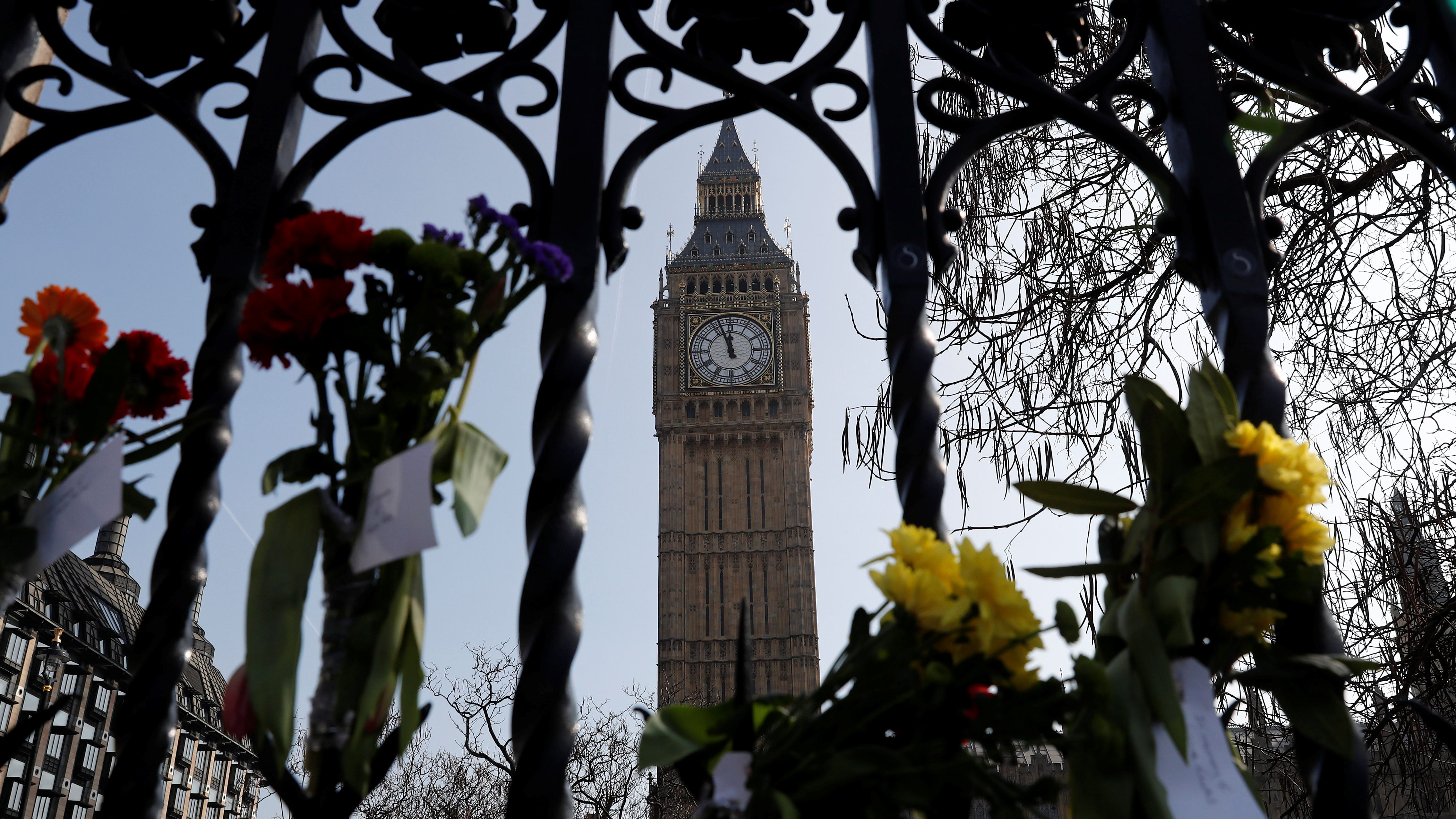 Floral tributes are attached to railings in Parliament Square following the attack in Westminster, central London, Britain March 27, 2017.