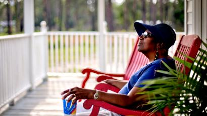 woman sitting on a front porch