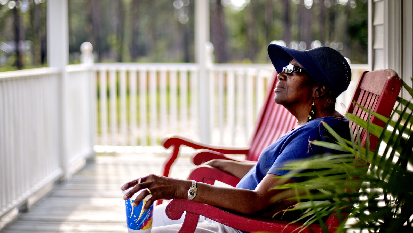 "Cornelia Bailey sits on the front porch of the Sapelo Island Cultural and Revitalization Society in the Hog Hammock community of Sapelo Island, Ga. on Thursday, May 16, 2013. ""You can't have a Geechee Gullah Corridor without the preservation of the Geechee-Gullah people,"" she says. ""They need to make sure the Geechee-Gullah people keep this land. This fight is not for us. The fight is for the next generation."" (AP Photo/David Goldman)"