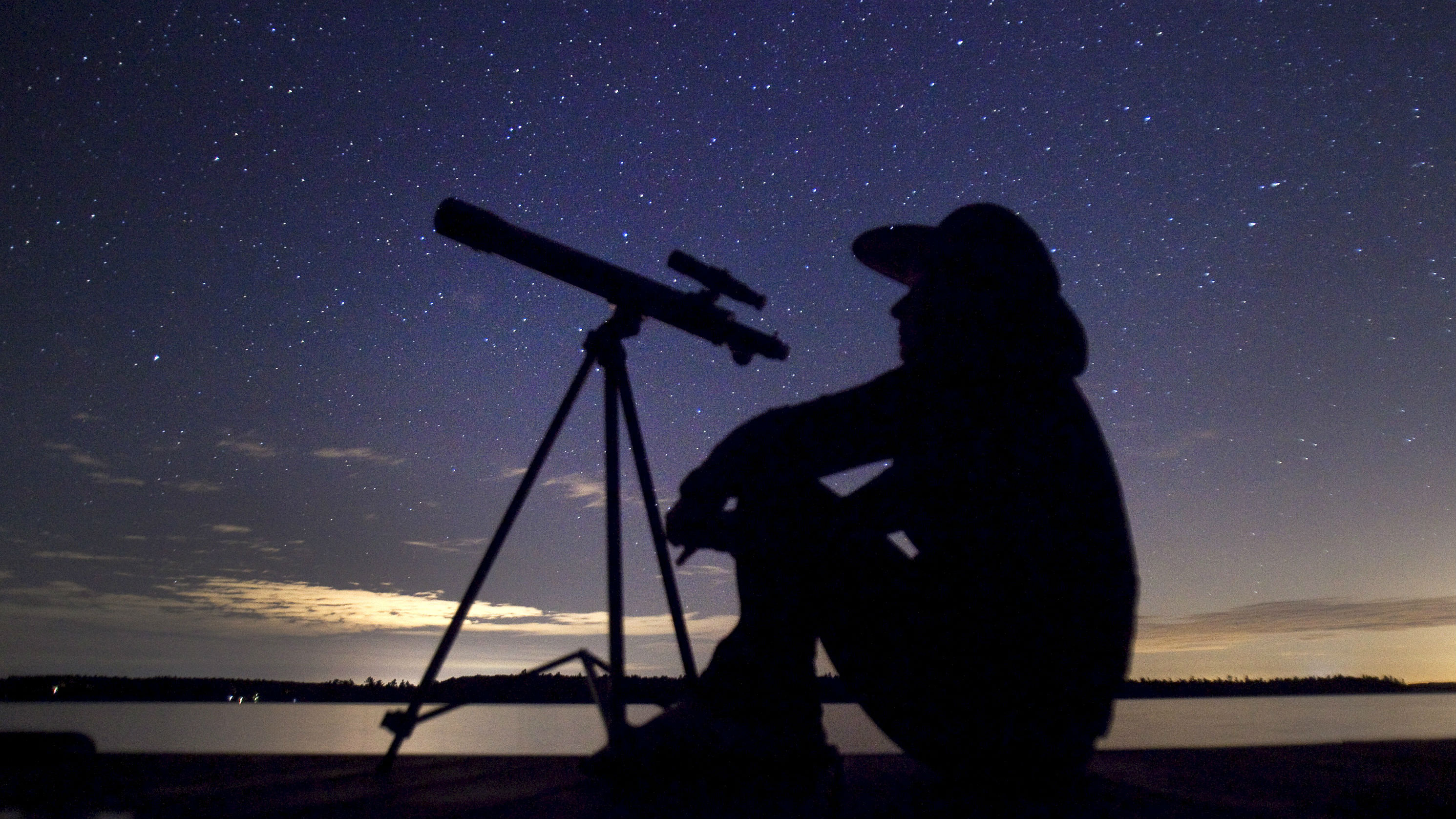 stargazer waits for the Perseid meteor shower to begin near Bobcaygeon, Ontario, August 12, 2015.