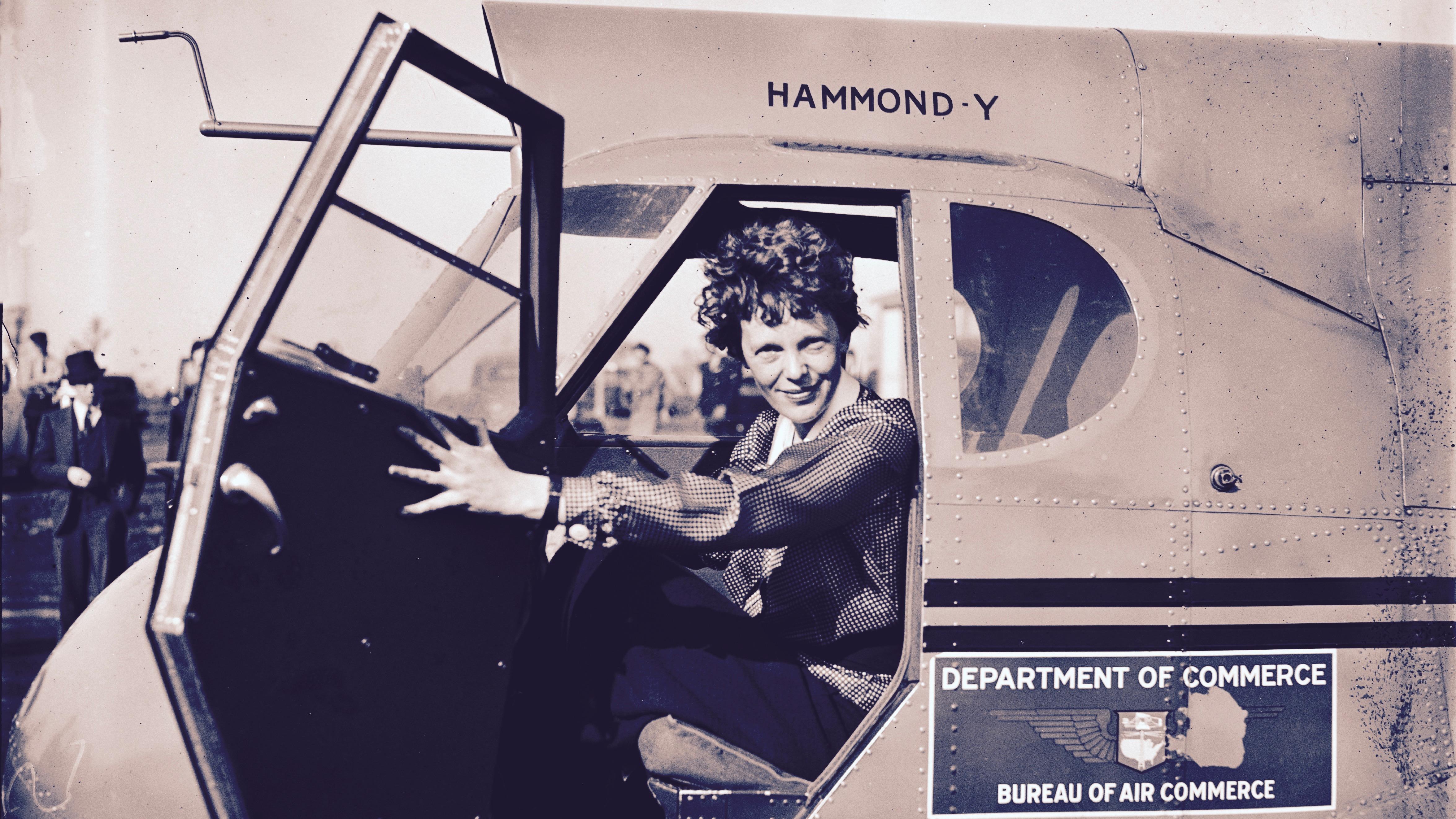 Amelia Earhart in a plane.