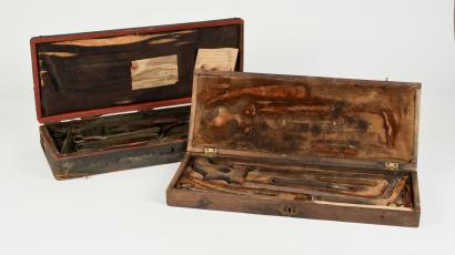 Two amputation kits up for auction.