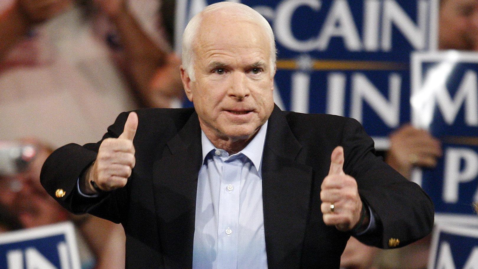 John McCain giving thumbs up.