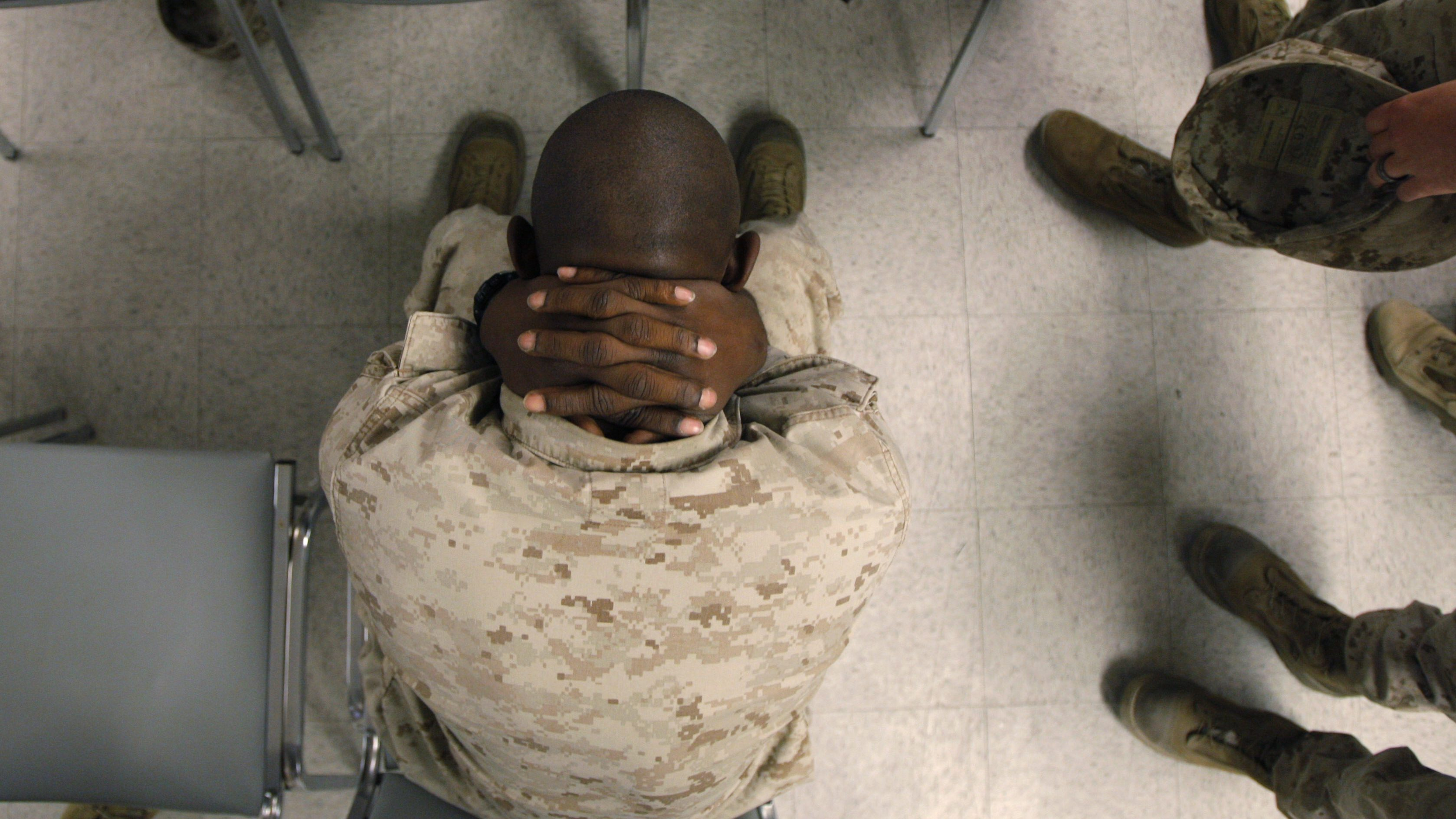 This Sept. 29, 2009 photo shows U.S. Marine Lance Cpl. Greg Rivers, 20, of Sylvester, Ga., holding his neck while waiting to take psychological tests at the Marine Corps Air Ground Combat Center in Twentynine Palms, Calif. The U.S. government is testing hundreds of Marines and soldiers before they ship out, in search of clues that might help predict who is most susceptible to post-traumatic stress disorder. (AP Photo/Jae C. Hong)