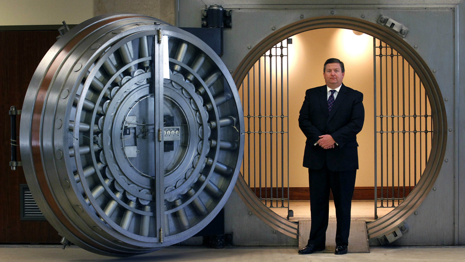 A man in front of a bank vault