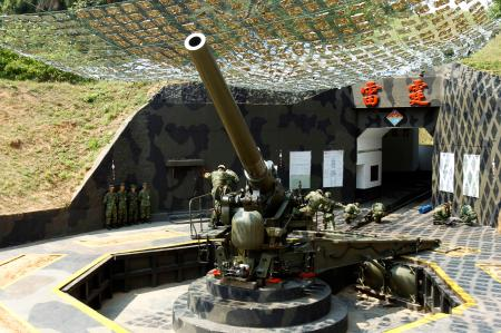 Taiwanese military soldiers load up a 240 mm Howitzer gun during an exercise on the eve of the 53rd anniversary of a massive bombing campaign on Taiwan's Kinmen island, Monday, Aug. 22, 2011. The Communist government forces on mainland China on August 23, 1958, resumed a massive artillery bombardment on Taiwan's outlying islands of Kinmen (formerly Quemoy) and Matsu, and threatened invasion, the event widely known as the 1958 Taiwan Strait Crisis, which continued until October.