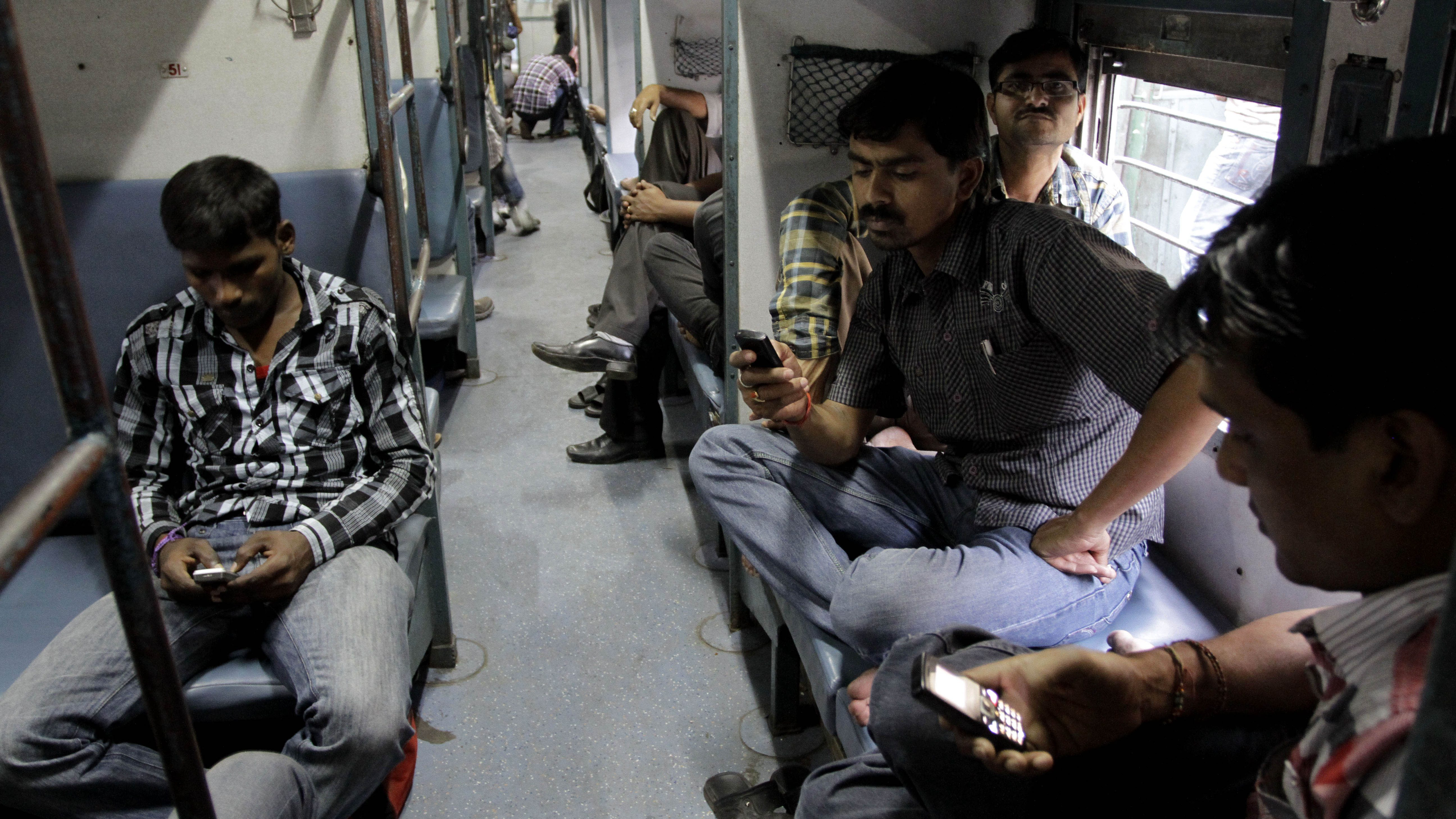 Commuters look at phones