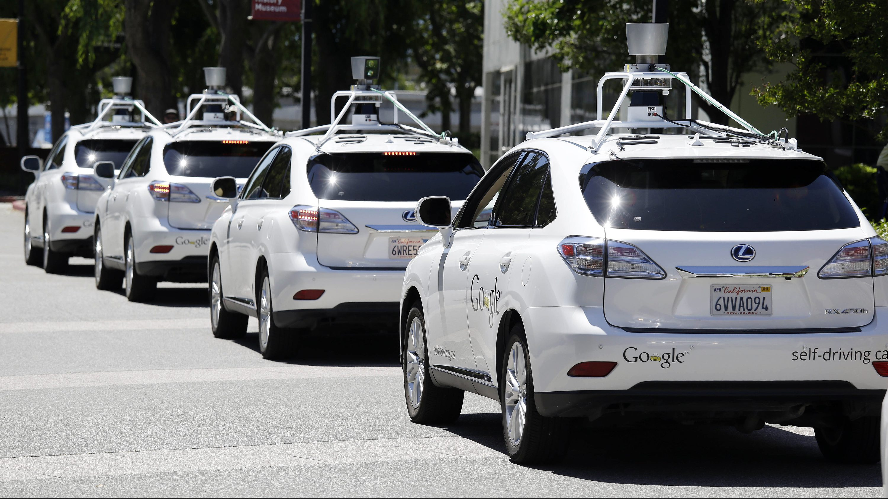 "FILE - This May 13, 2014, file photo shows a row of Google self-driving Lexus cars at a Google event outside the Computer History Museum in Mountain View, Calif. California regulators release safety reports filed by 11 companies that have been testing self-driving car prototypes on public roads on Wednesday, Feb. 1, 2017. The papers report the number of times in 2016 that human backup drivers took control from the cars' self-driving software, though companies argue such ""disengagements"" don't always reflect something going wrong. (AP Photo/Eric Risberg, File)"