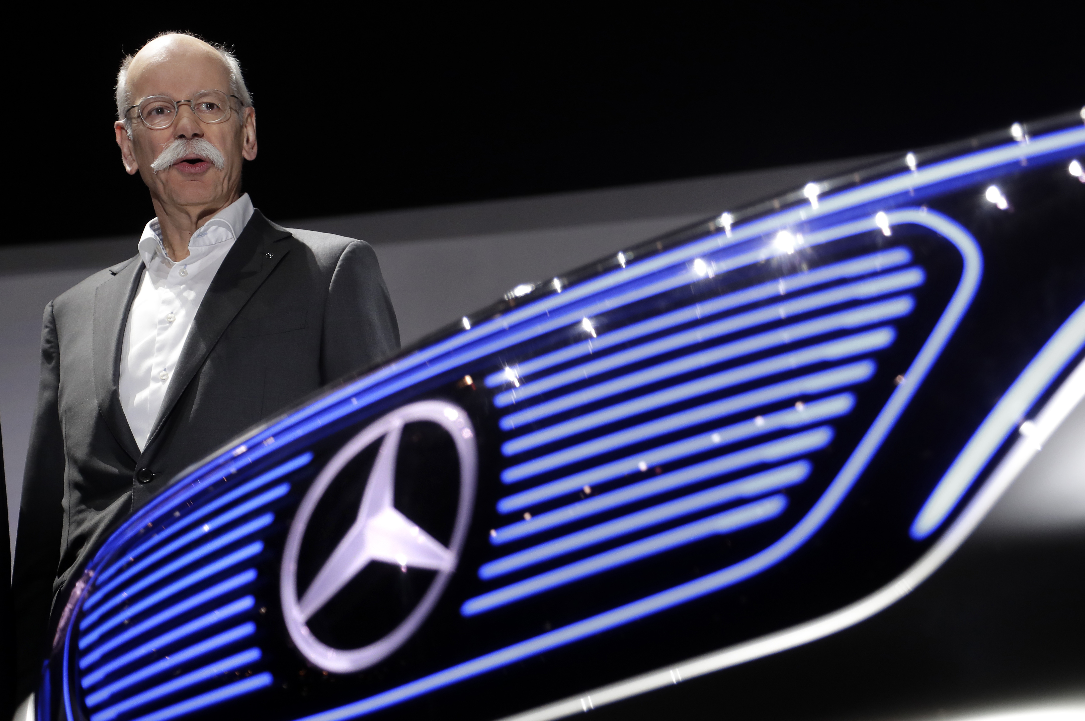 Dieter Zetsche, CEO of the Daimler AG, poses next to a car prior to the shareholders meeting of the car maker in Berlin, Germany, Wednesday, March 29, 2017.