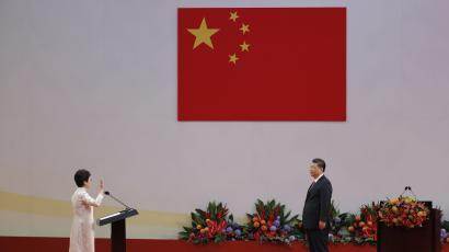 Chinese President Xi Jinping, right, administers the oath to Hong Kong's new Chief Executive Carrie Lam for a five-year term in office at the Hong Kong Convention and Exhibition Center in Hong Kong Saturday, July 1, 2017.