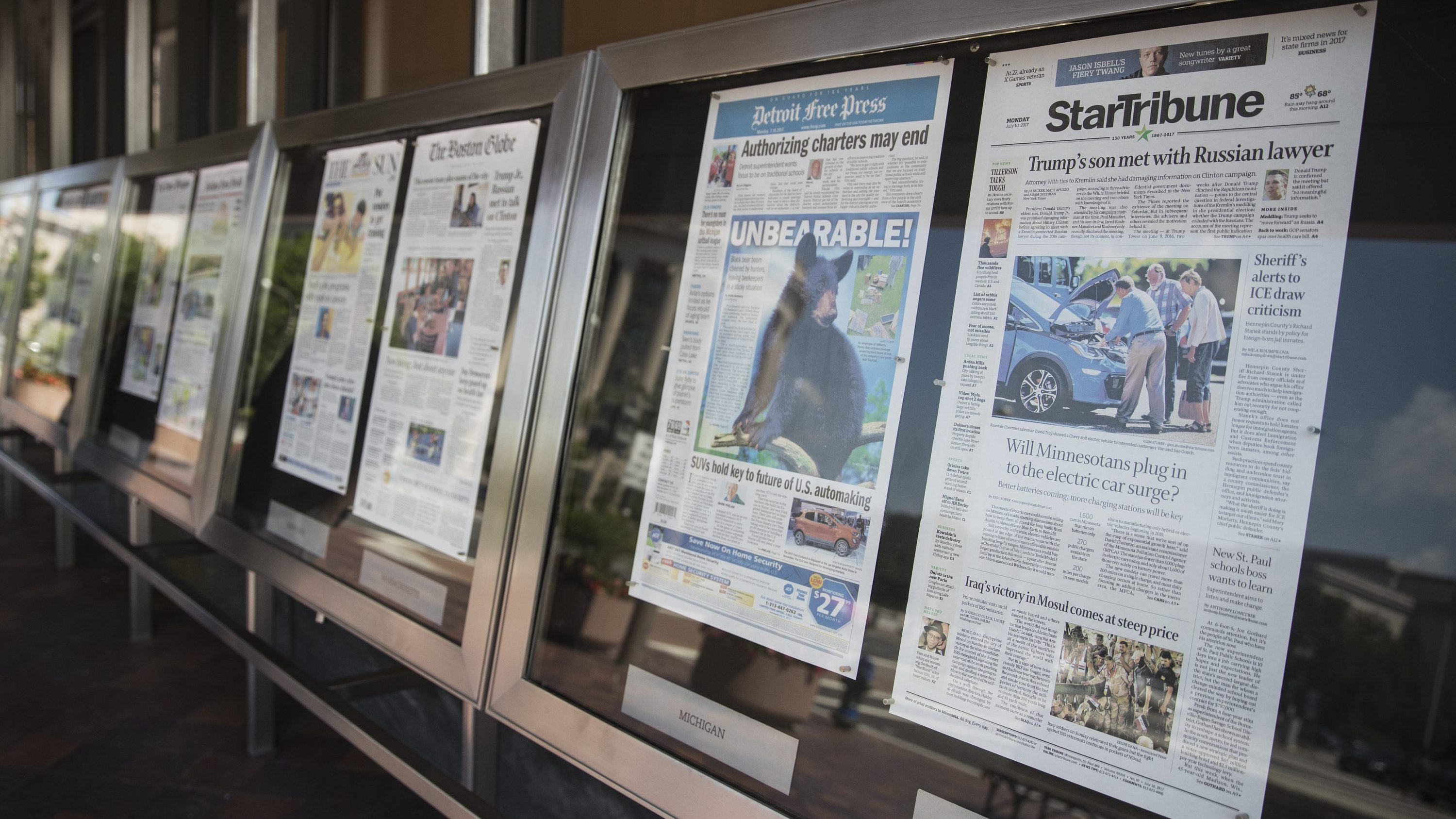Newspaper front pages are displayed at the Newseum in Washington, Monday, July 10, 2017. News outlets are seeking permission from Congress for the right to negotiate jointly with Google and Facebook, two companies that dominate online advertising and online news traffic.