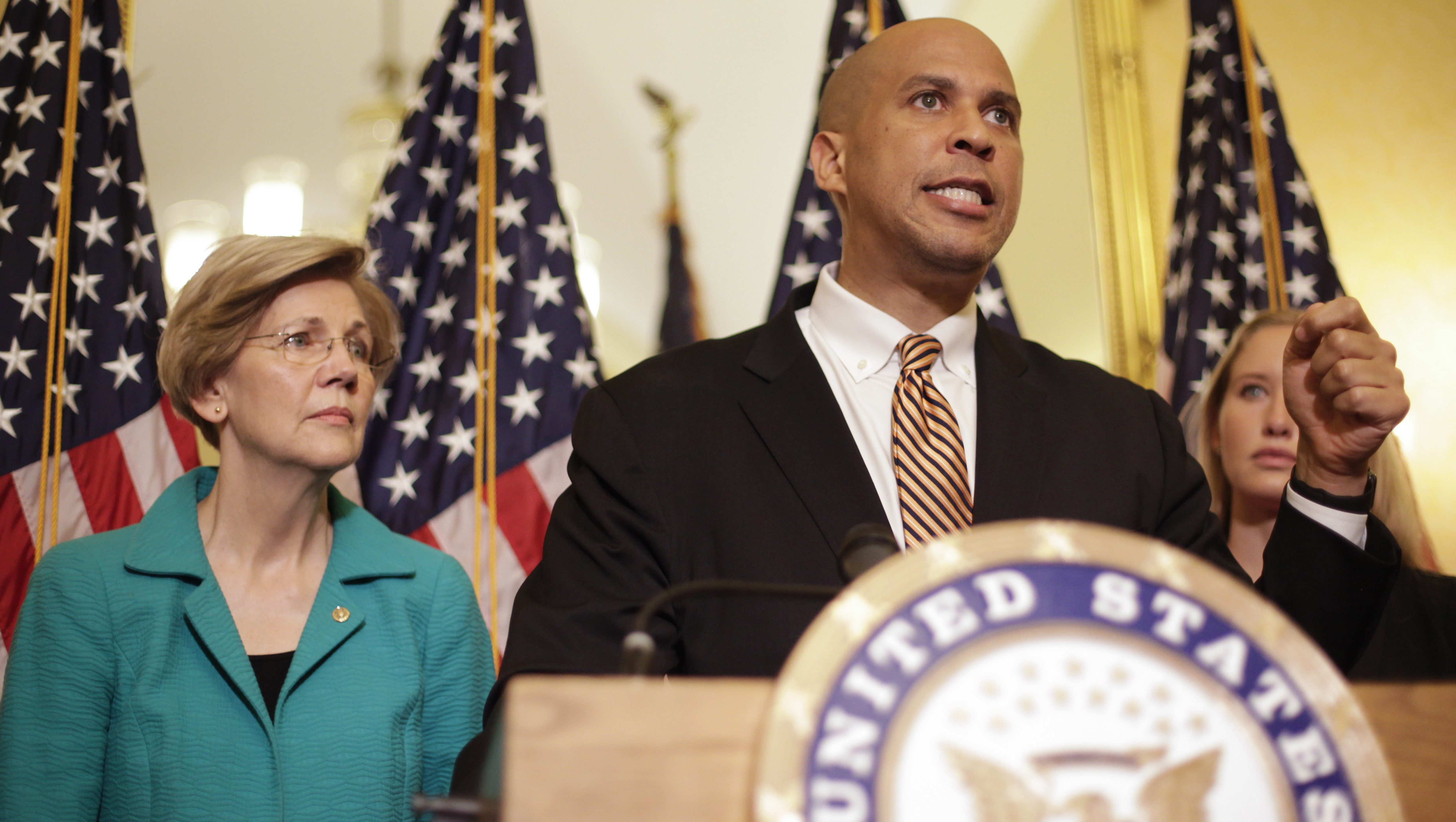 Sen. Cory Booker, D-N.J. and Sen. Elizabeth Warren, D-Mass. participate in a news conference on Capitol Hill in Washington, Tuesday, July 11, 2017, to discuss the introduction of the Dignity for Incarcerated Women Act. The bill helps address some of the unique challenges women face while in prison. (AP Photo/Pablo Martinez Monsivais)