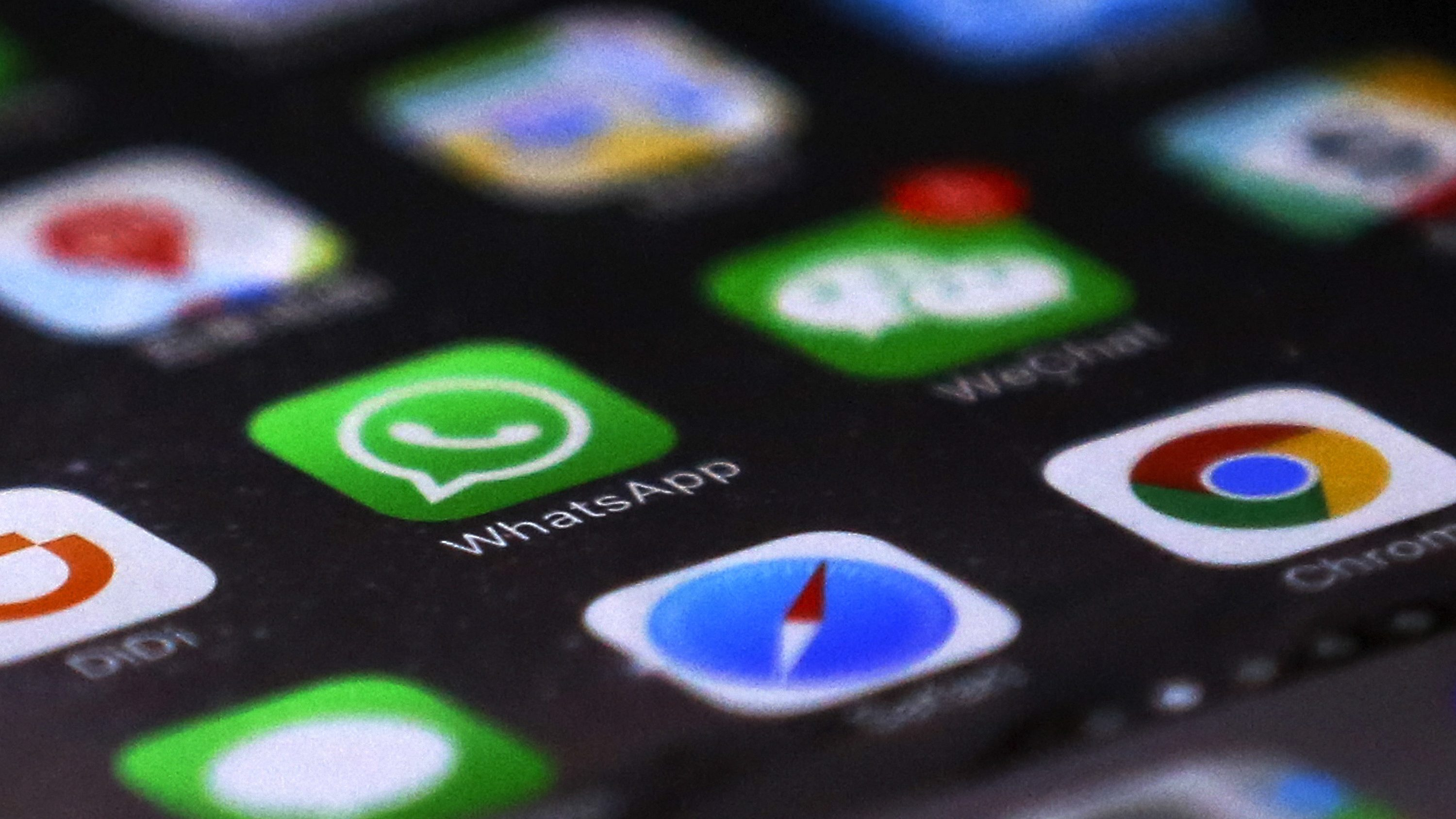 WhatsApp is seen with other mobile apps on a smartphone in Beijing, Tuesday, July 18, 2017. Users of WhatsApp in China and security researchers reported Tuesday widespread service disruptions amid fears that the popular messaging service may be at least partially blocked by authorities in the world's most populous country. The app was partly inaccessible unless virtual private network software was used to circumvent China's censorship apparatus, known colloquially as The Great Firewall.