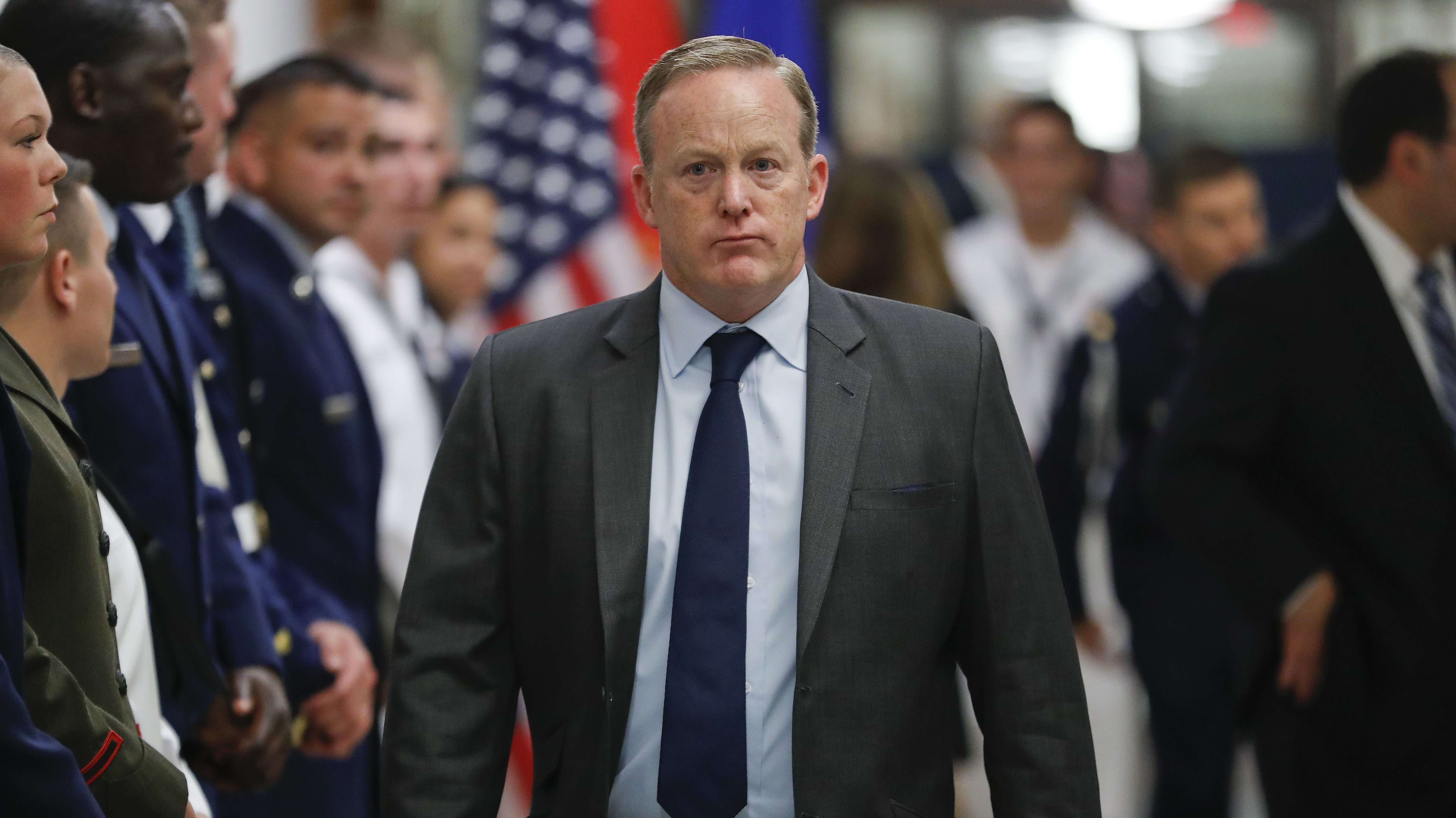 White House press secretary Sean Spicer walks down the hallway during President Donald Trump's visit to the Pentagon, Thursday, July 20, 2017.   White House Press Secretary Sean Spicer has resigned over hiring of new communications aide.  (AP Photo/Pablo Martinez Monsivais)