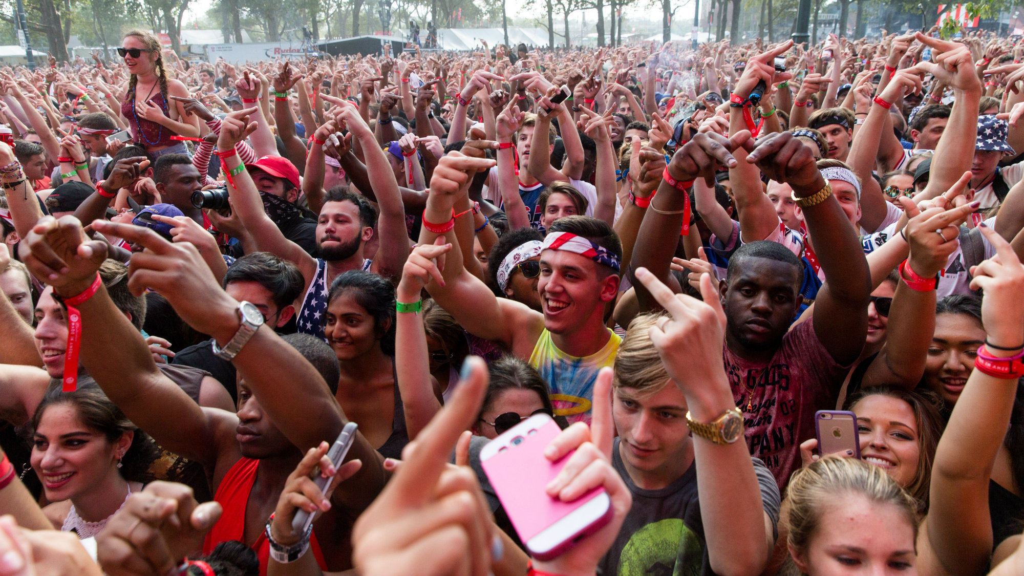 Crowd of people holding up their middle fingers