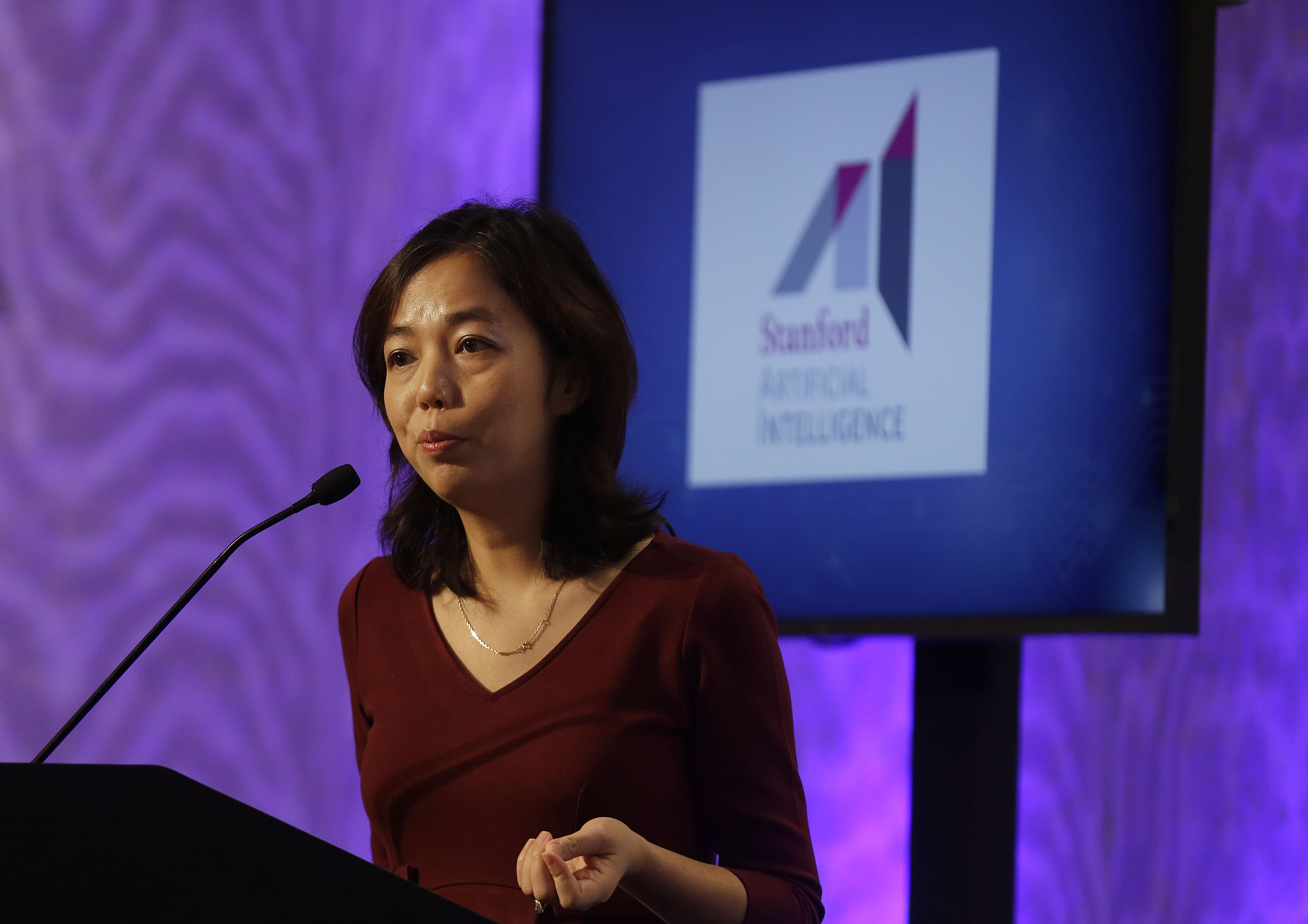 Fei-Fei Li, associate professor at Stanford, speaks at a news conference in East Palo Alto, Calif., Friday, Sept. 4, 2015. Toyota announced it is investing $50 million with Stanford University and the Massachusetts Institute of Technology in hopes of gaining an edge in an accelerating race to phase out human drivers. (AP Photo/Jeff Chiu)