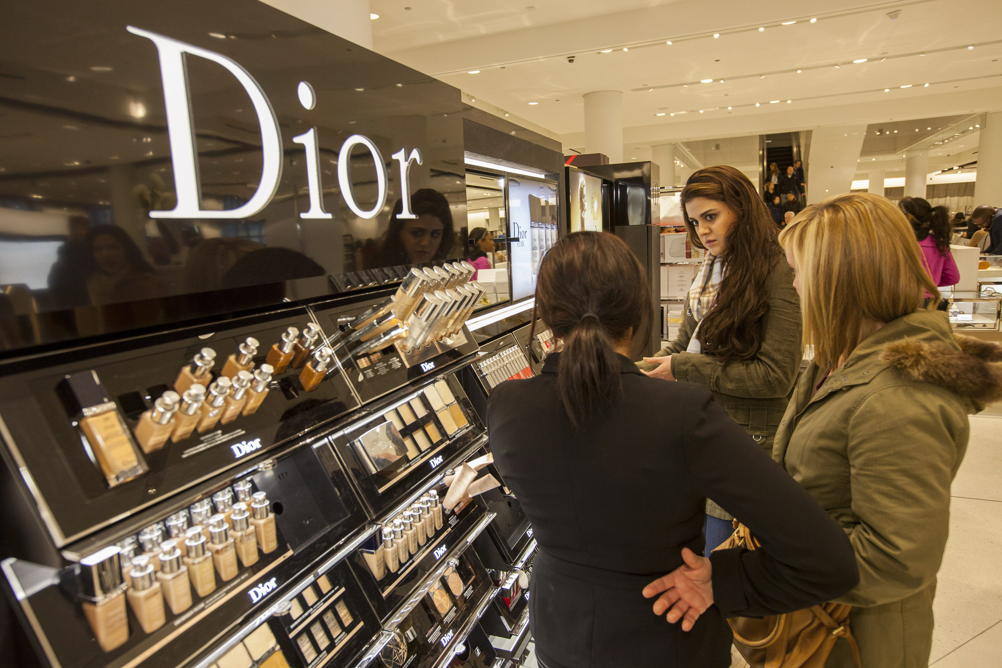 Shoppers at a Nordstrom Dior counter.