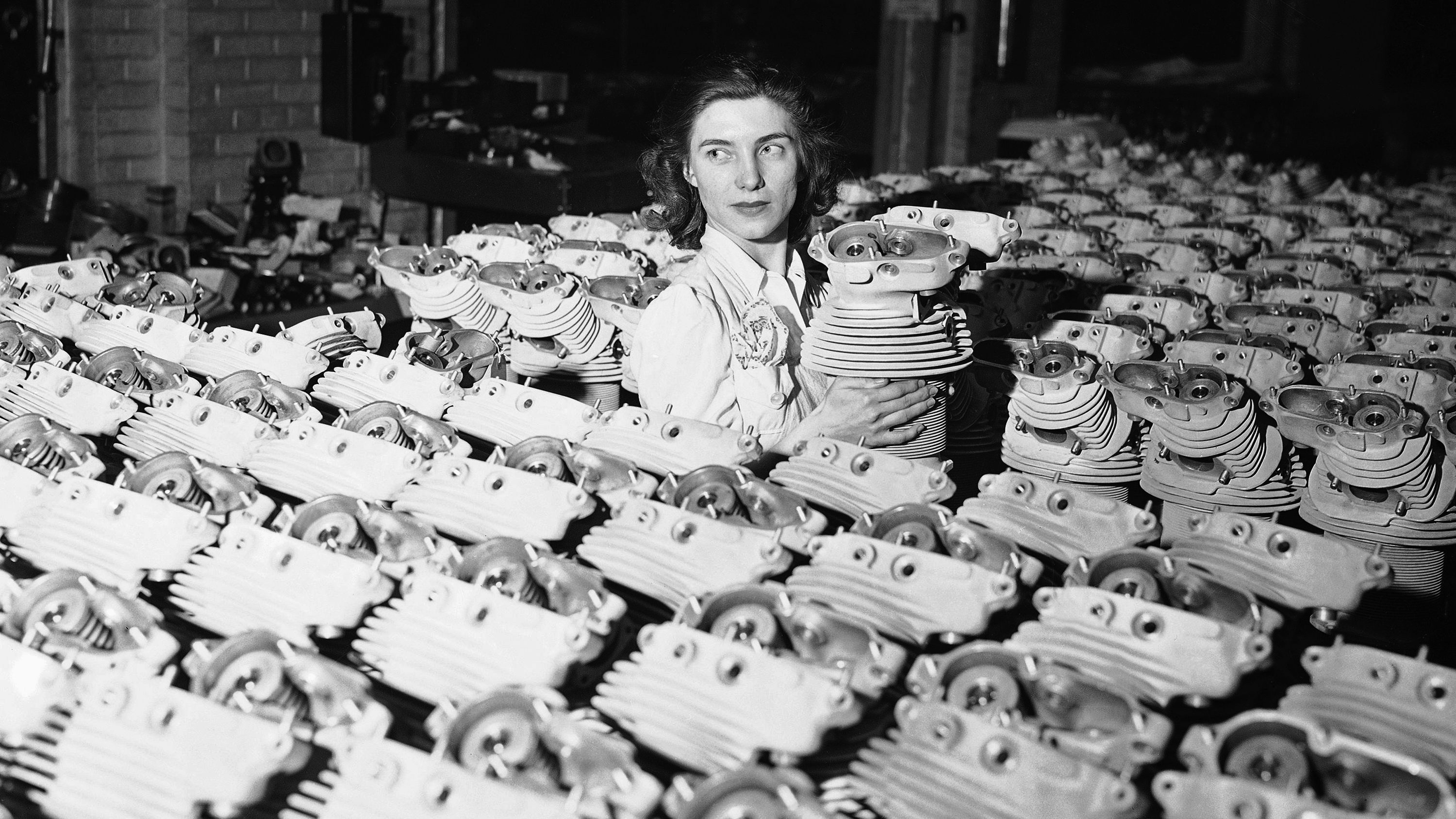 Ida Ungerer, 24, is shown with airplane engine cylinders at Naval aircraft factory in Philadelphia navy yard, March 3, 1942.