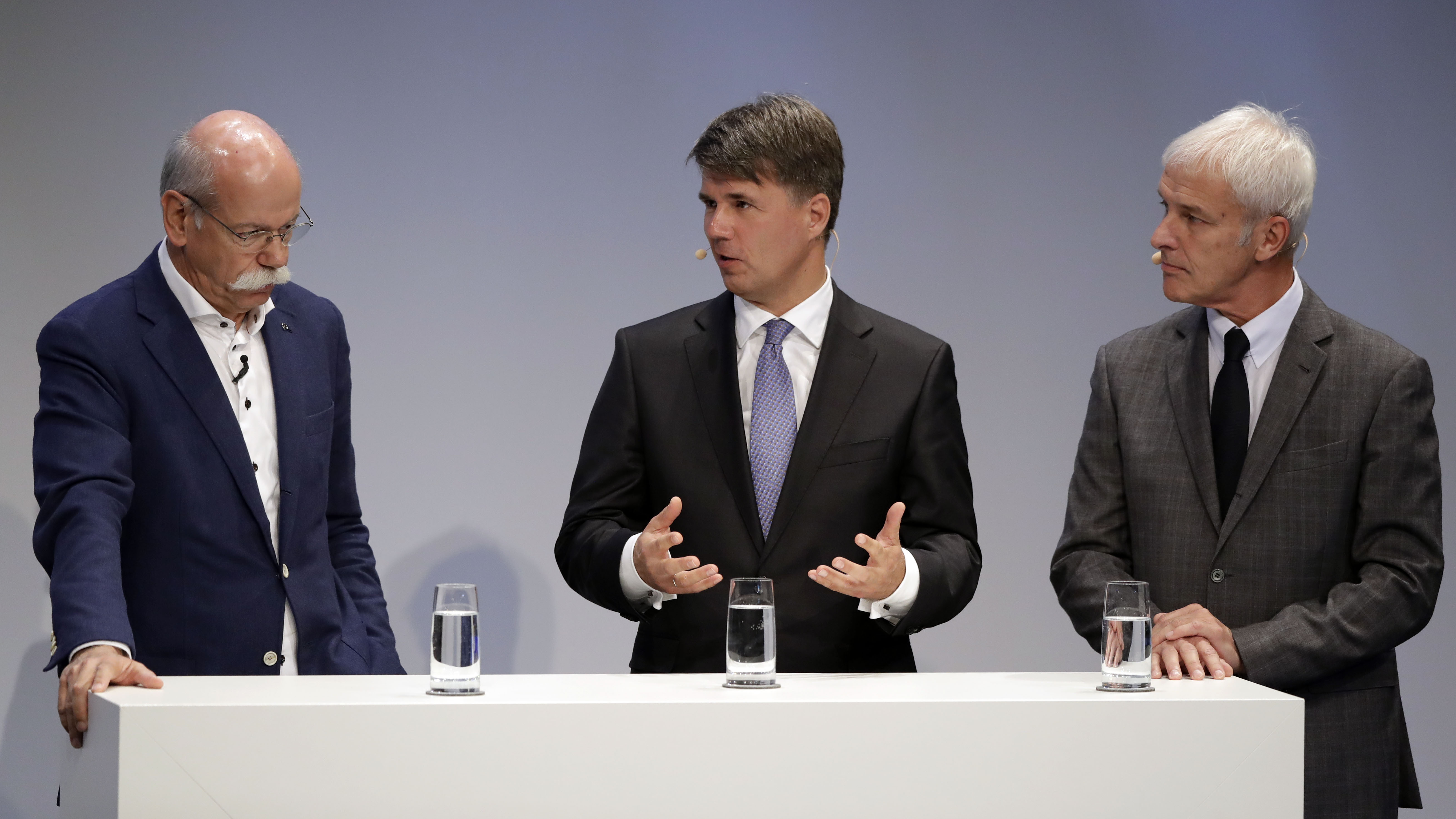 CEO of the German car manufacturer Daimler AG, Dieter Zetsche, from left, CEO of the German car manufacturer BMW, Harald Krueger, and Matthias Mueller, CEO of German car manufacturer Volkswagen, attend an Automotive Summit of BMW, Mercedes and Volkswagen in Munich, Germany, Wednesday, Nov. 9, 2016.