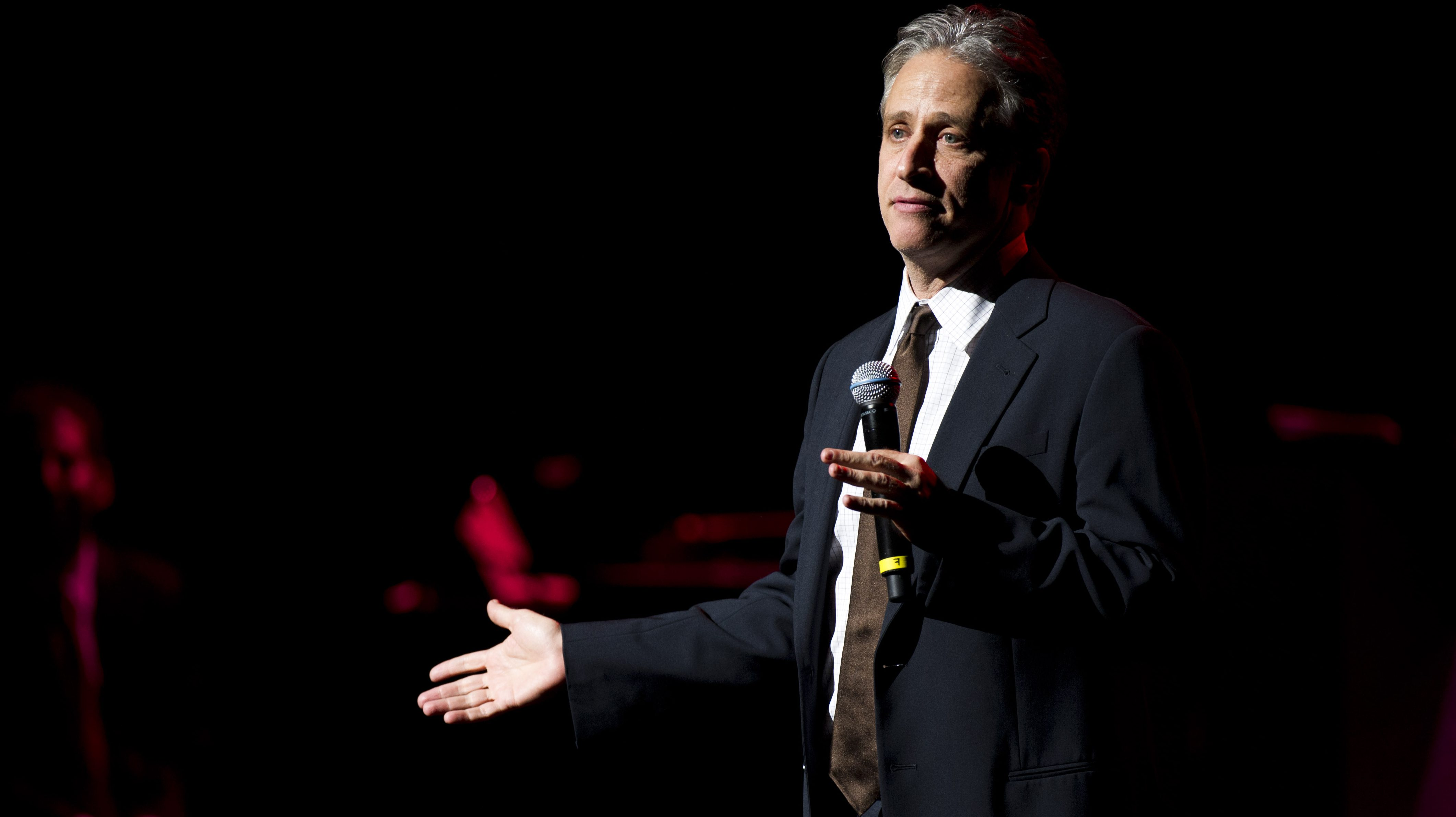 Jon Stewart performs at the 6th Annual Stand Up For Heroes benefit concert for injured service members and veterans on Thursday, Nov. 8, 2012 in New York. (Photo by Charles Sykes/Invision/AP)