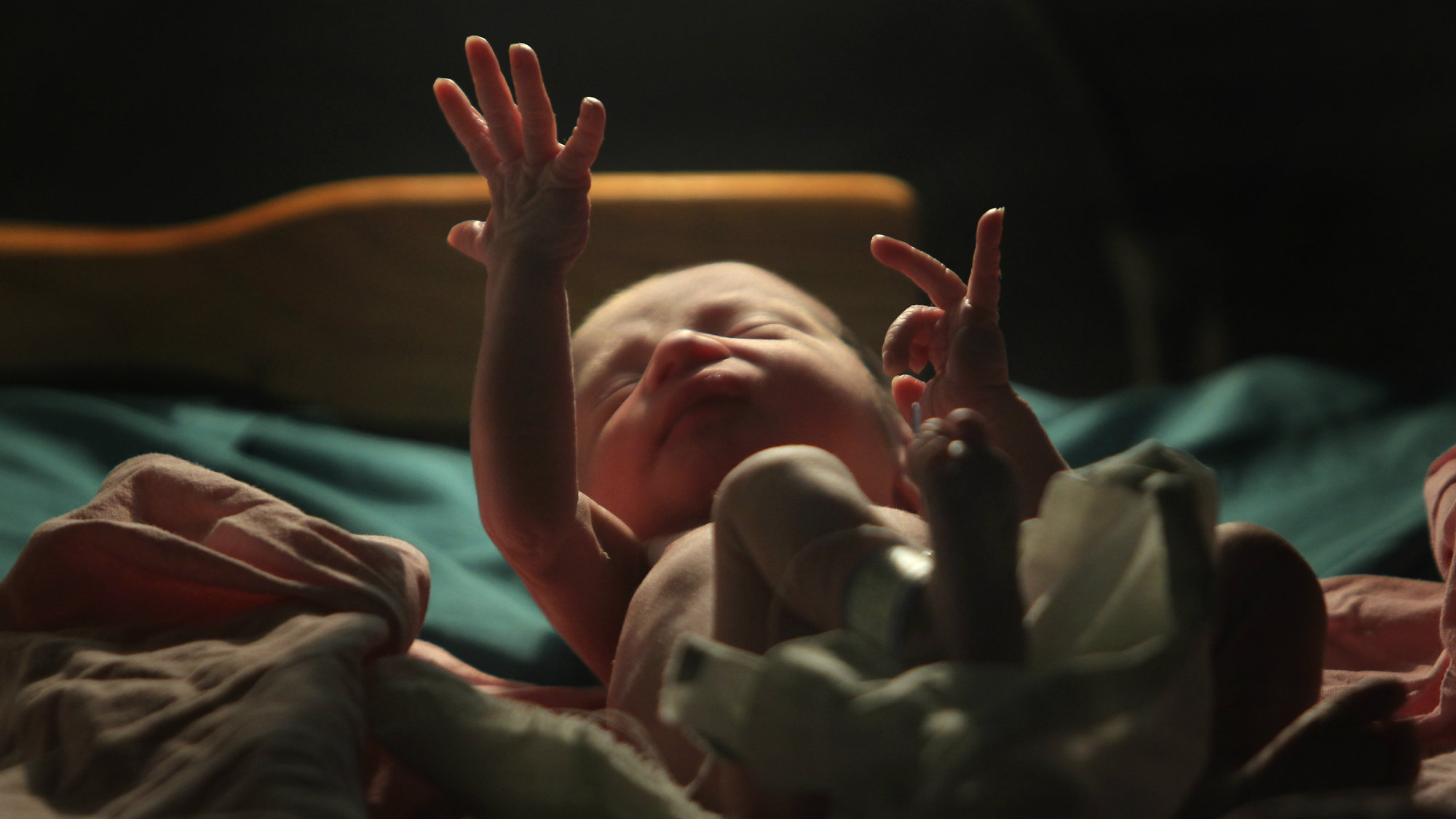 A baby gestures minutes after he was born inside the pediatric unit at hospital Escuela in Tegucigalpa October 21, 2011.