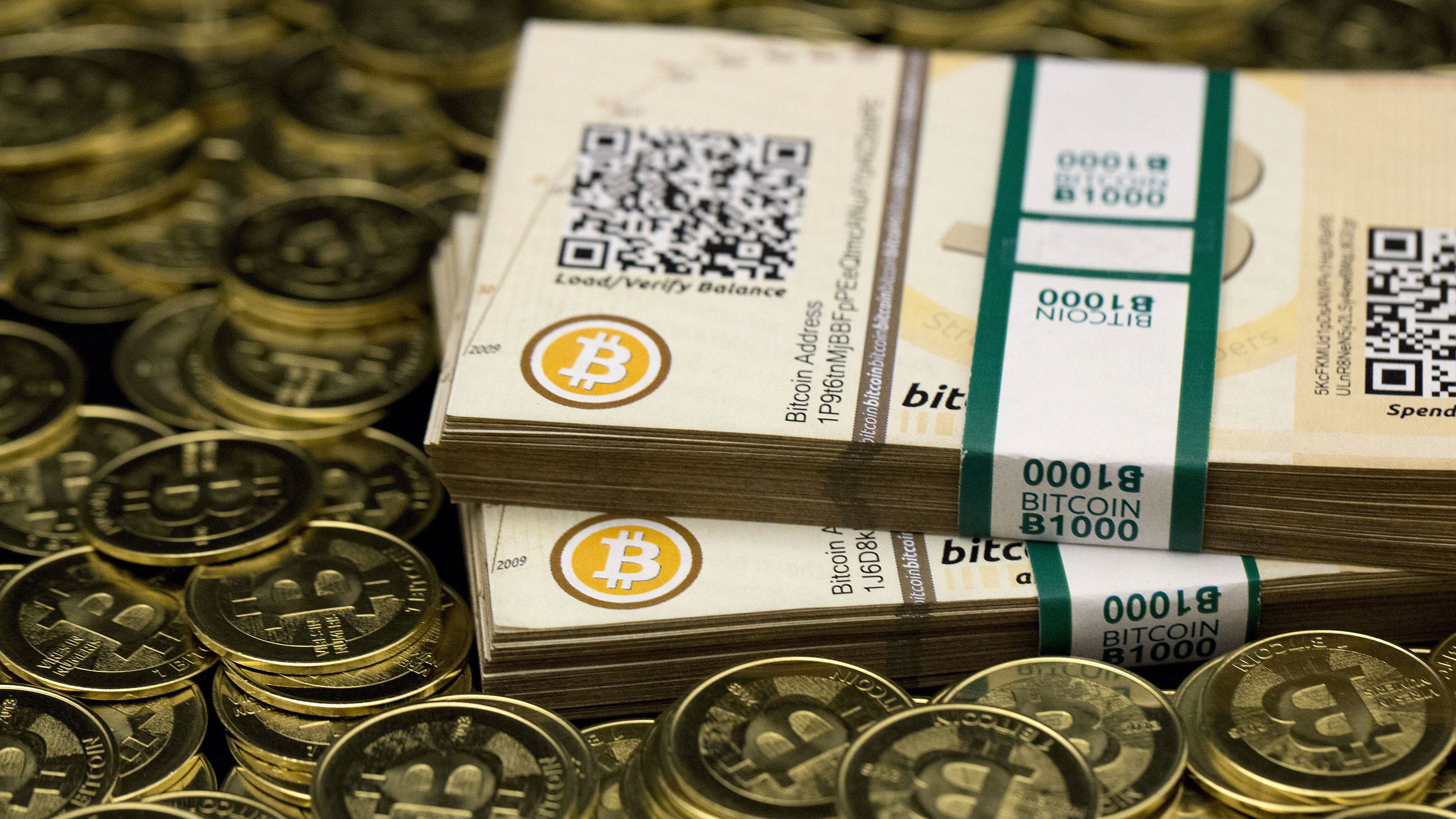 """Some of Bitcoin enthusiast Mike Caldwell's coins and paper vouchers, often called """"paper wallets"""", are pictured at his office in this photo illustration in Sandy, Utah, January 31, 2014. Caldwell recommended their use as a way to store Bitcoins offline."""