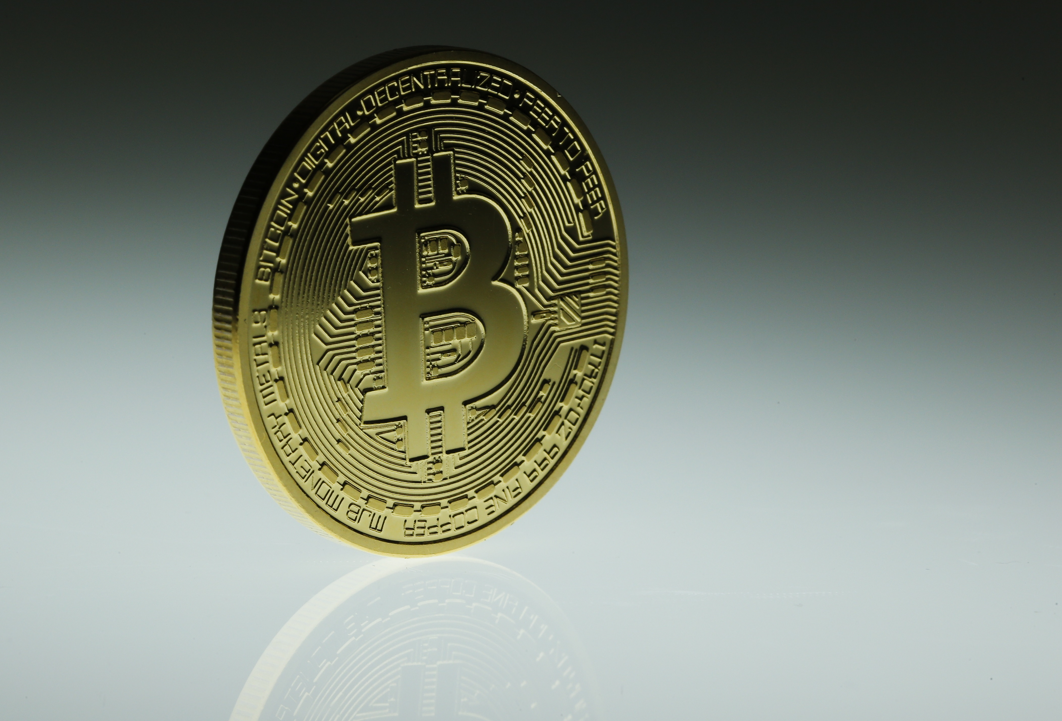 A mock Bitcoin is displayed on a table in an illustration picture taken in Berlin January 7, 2014. European banking regulators warn consumers against hacking and other risks associated with online currencies like Bitcoin. It follows similar advisories from the Bank of France and the Chinese central bank - and adds pressure to calls for the sector to be regulated.