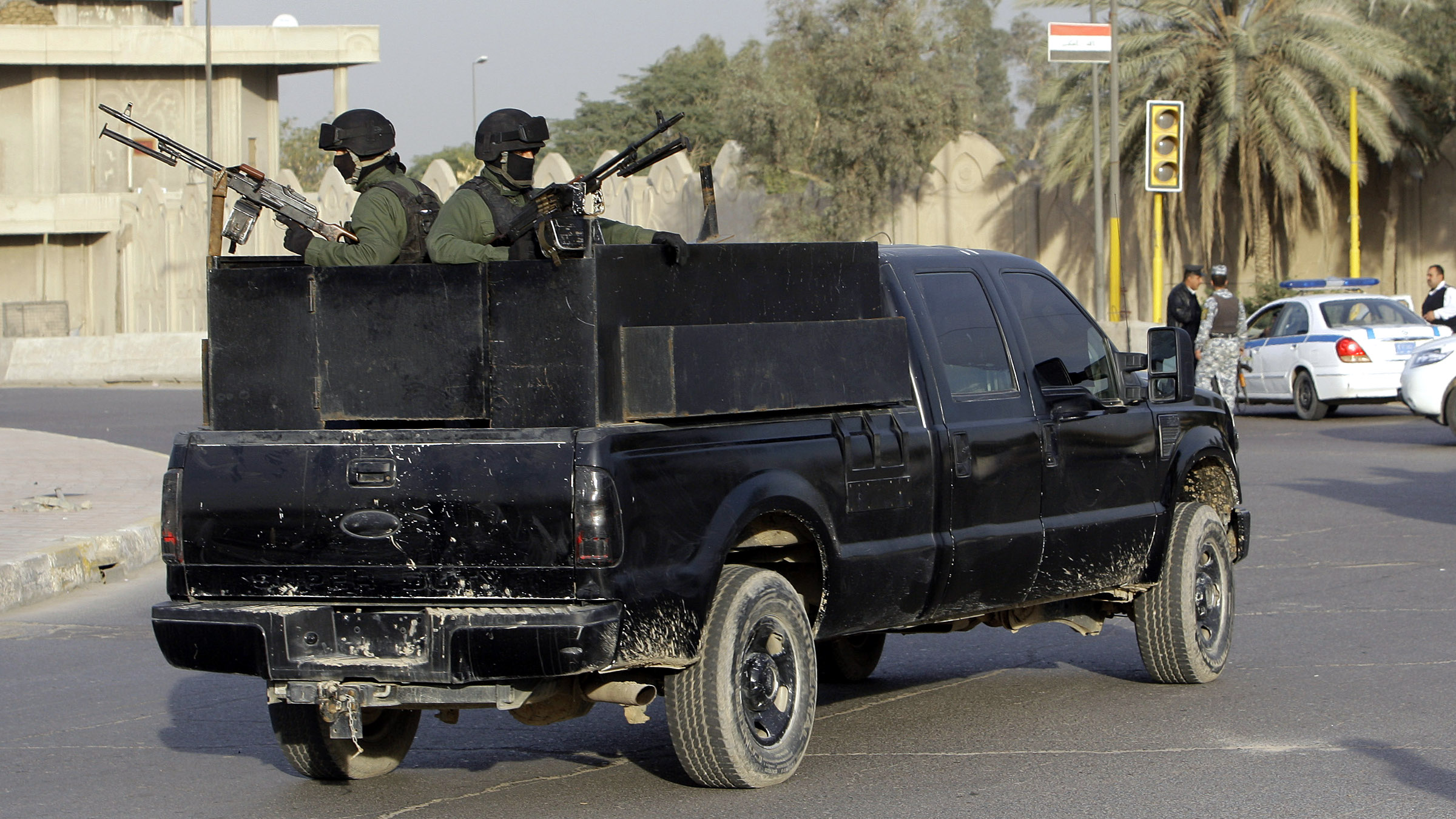A private security company's armored vehicle rolls through al-Nisoor square,Baghdad, Iraq, Saturday, Jan. 2, 2010. A U.S. federal judge has dismissed all charges against five Blackwater Worldwide security guards accused in the 2007 killing of unarmed Iraqi civilians, in a case that has inflamed anti-American sentiment in Iraq.
