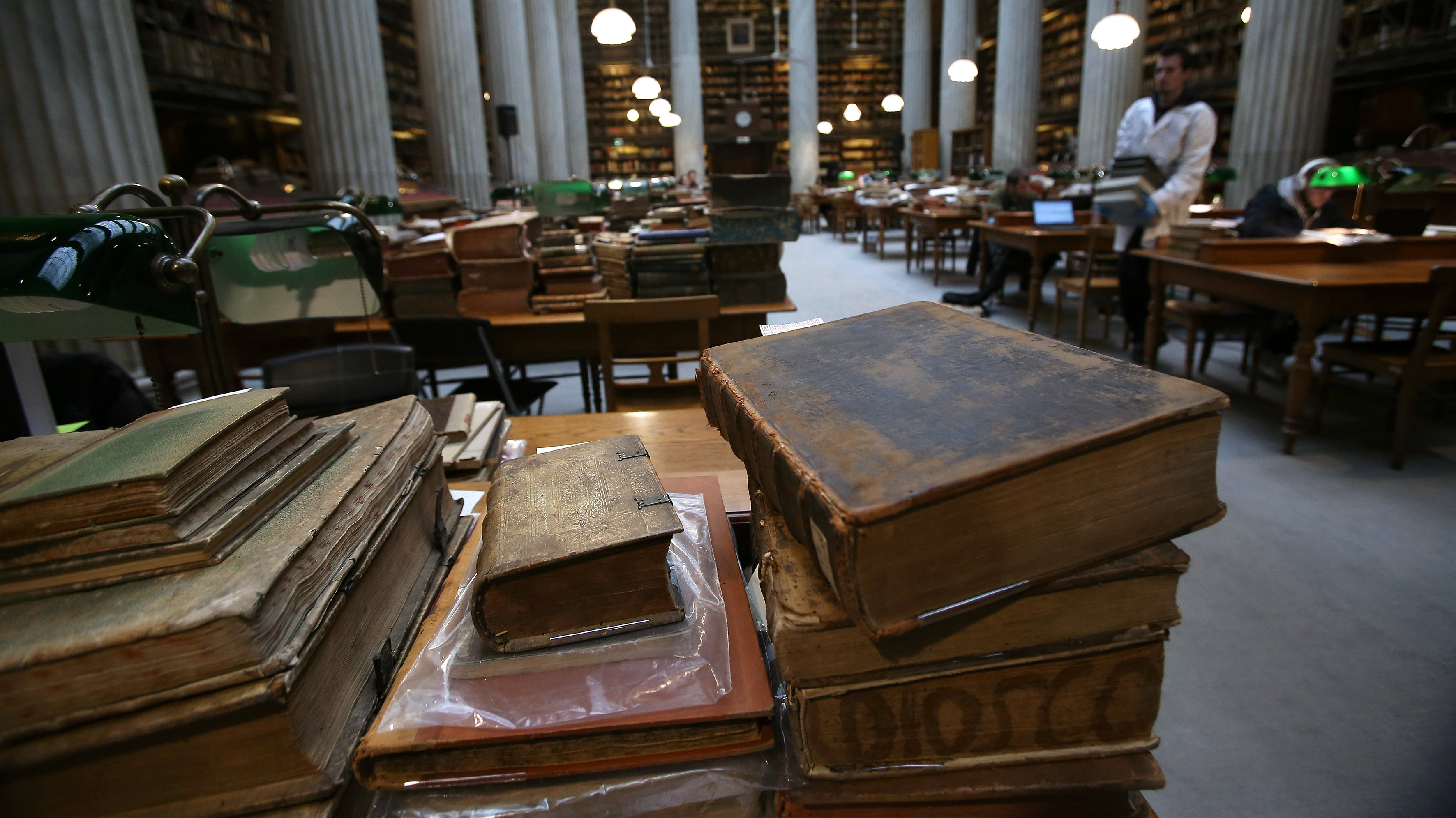 Librarians work in the reading room to complete a digital catalogue for the collections of the National Library in Athens, Greece, 31 January 2017