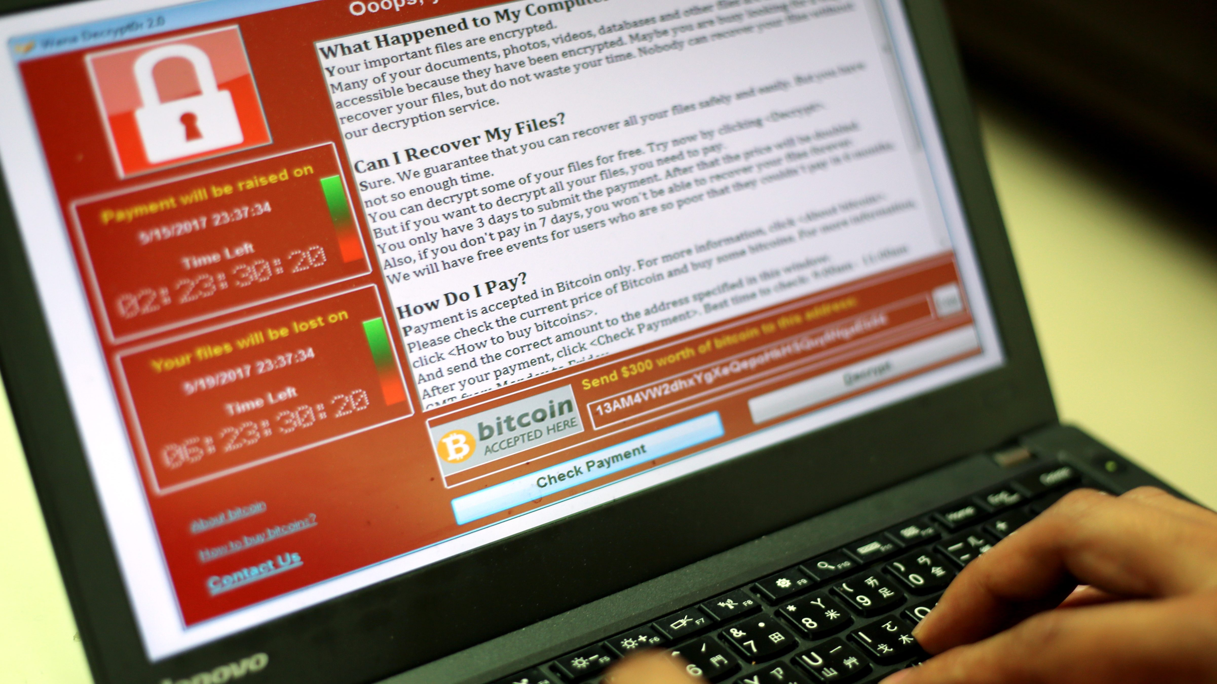 A programer shows a sample of a ransomware cyberattack on a laptop in Taipei, Taiwan, 13 May, 2017. According to news reports, a 'WannaCry' ransomware cyber attack hits thousands of computers in 99 countries encrypting files from affected computer units and demanding 300 US dollars through bitcoin to decrypt the files.