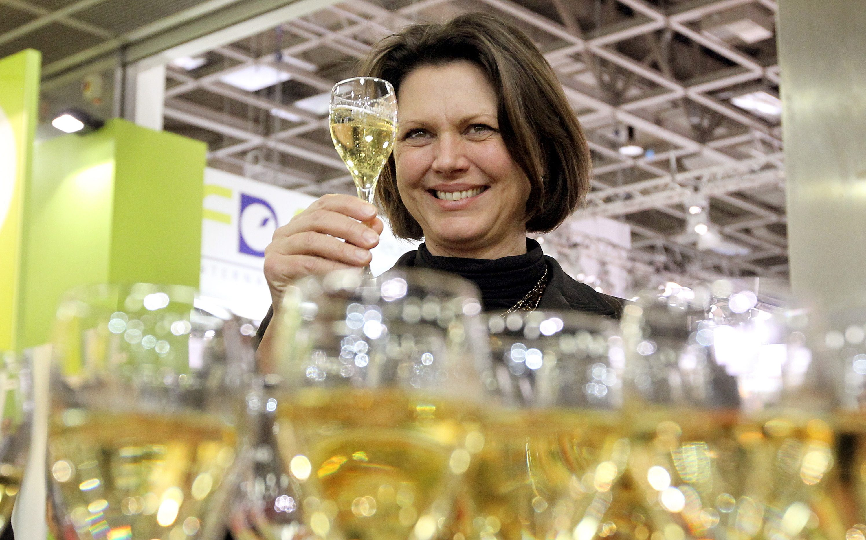 German Minister of Agriculture Ilse Aigner tries champagne at Fruit Logistica in Berlin,Germany, 08 February 2012. The world's largest trade fair about fruit and vegetables opens to the public from 08 until 10 February 2012.