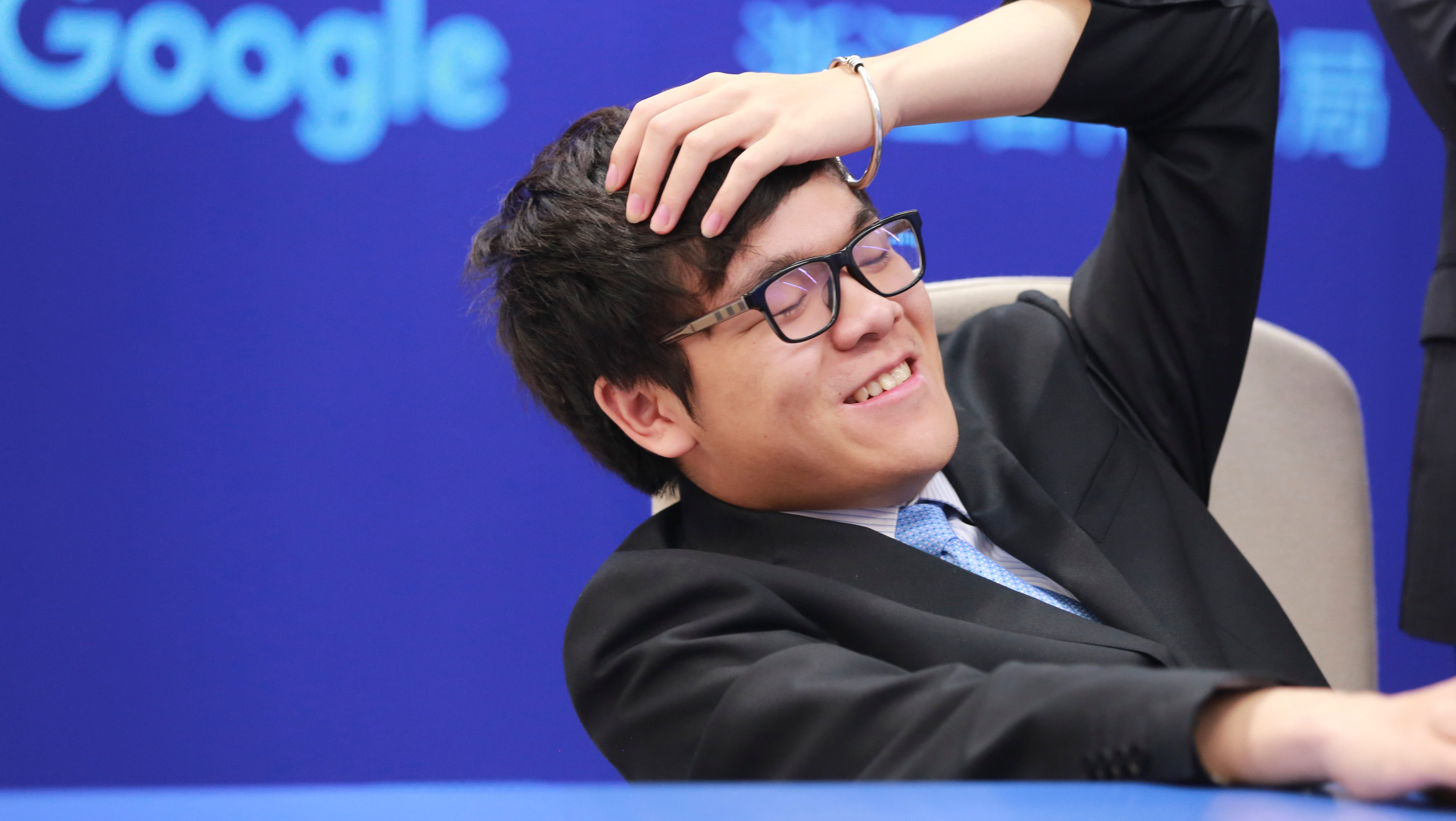 Chinese Go player Ke Jie reacts during his second match against Google's artificial intelligence program AlphaGo at the Future of Go Summit in Wuzhen, Zhejiang province, China May 25, 2017.