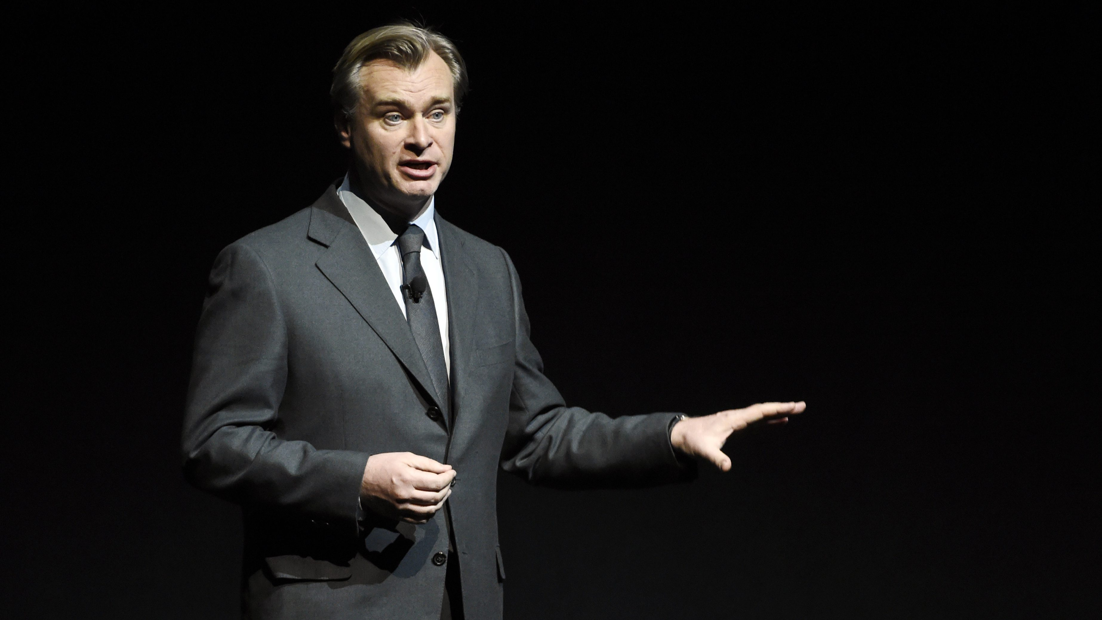 """Christopher Nolan, director of the upcoming film """"Dunkirk,"""" discusses the film during the Warner Bros. Pictures presentation at CinemaCon 2017 at Caesars Palace on Wednesday, March 29, 2017, in Las Vegas. (Photo by Chris Pizzello/Invision/AP)"""