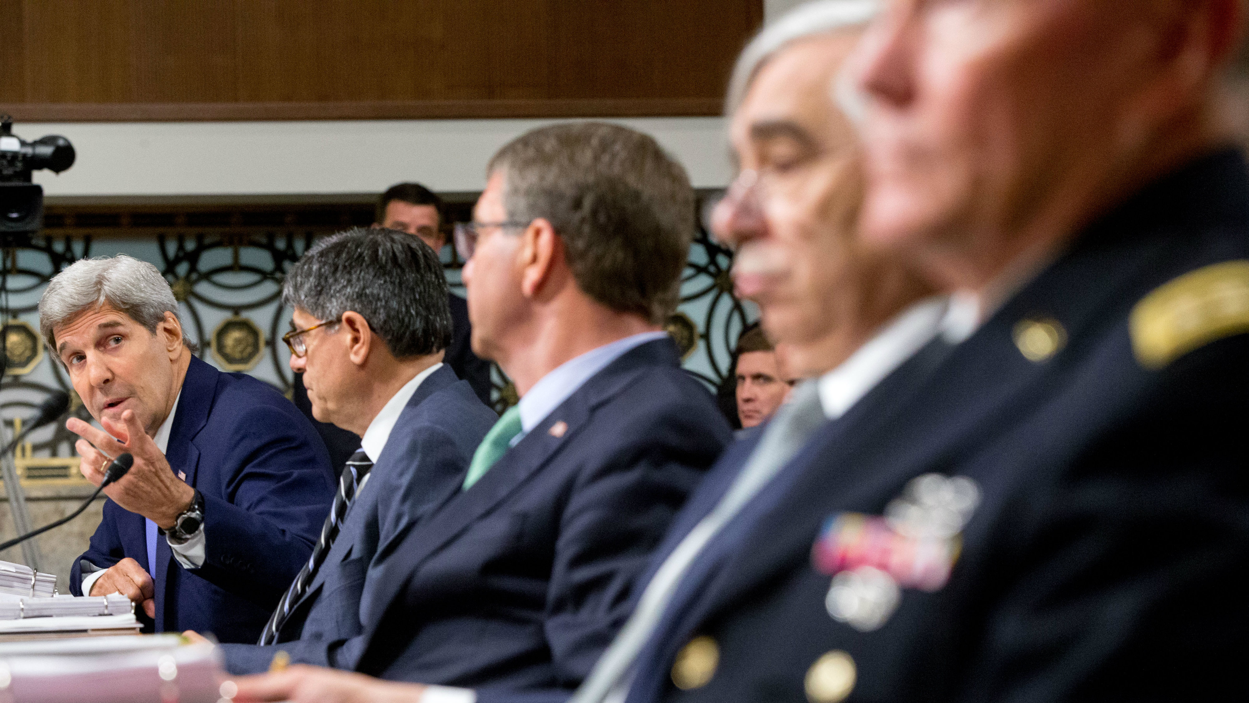 Secretary of State John Kerry, left, testifies on Capitol Hill in Washington, Wednesday, July 29, 2015, before the Senate Armed Services Committee hearing , on the impacts of the Joint Comprehensive Plan of Action (JCPOA) on U.S. Interests and the Military Balance in the Middle East. From left are, Kerry, Treasury Secretary Jacob Lew, Defense Secretary Ash Carter, Energy Secretary Ernest Moniz, and Joint Chiefs Chairman Gen. Martin Dempsey appear . (AP Photo/Andrew Harnik)