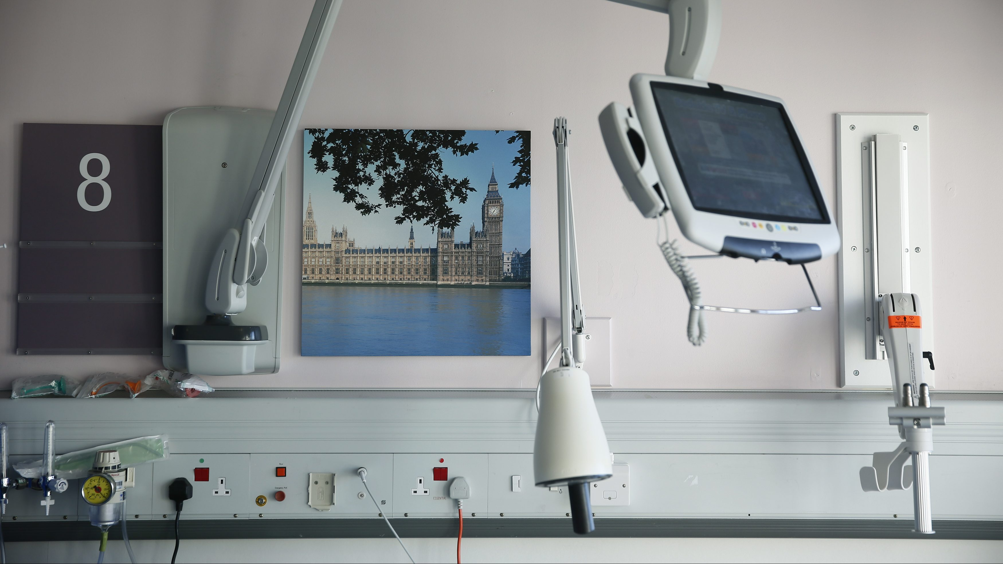 A picture of the Houses of Parliament and Big Ben is seen on a ward at St Thomas' Hospital in central London January 28, 2015. Dearly-loved and overburdened, Britain's national health system has become the top issue for voters ahead of May's election, after winter brought headlines of ambulances queueing outside hospitals and patients languishing on trolleys for hours.The National Health Service (NHS) delivers care for free to the whole population from cradle to grave and accounts for a third of government spending on public services. Photograph taken January 28, 2015.