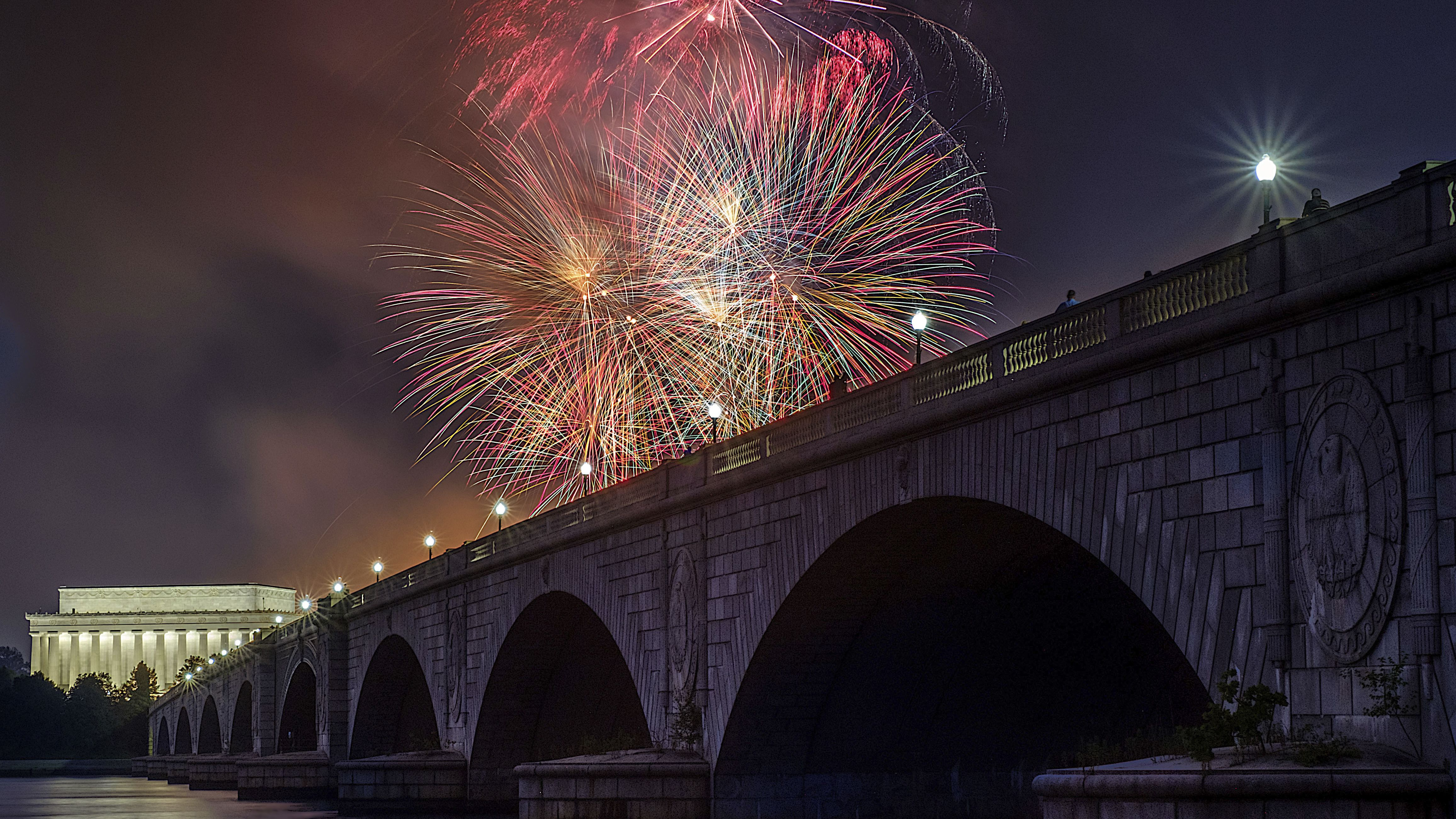Fireworks burst over the Memorial Bridge and Lincoln Memorial during Independence Day celebrations on the National Mall in Washington, Tuesday, July 4, 2017.