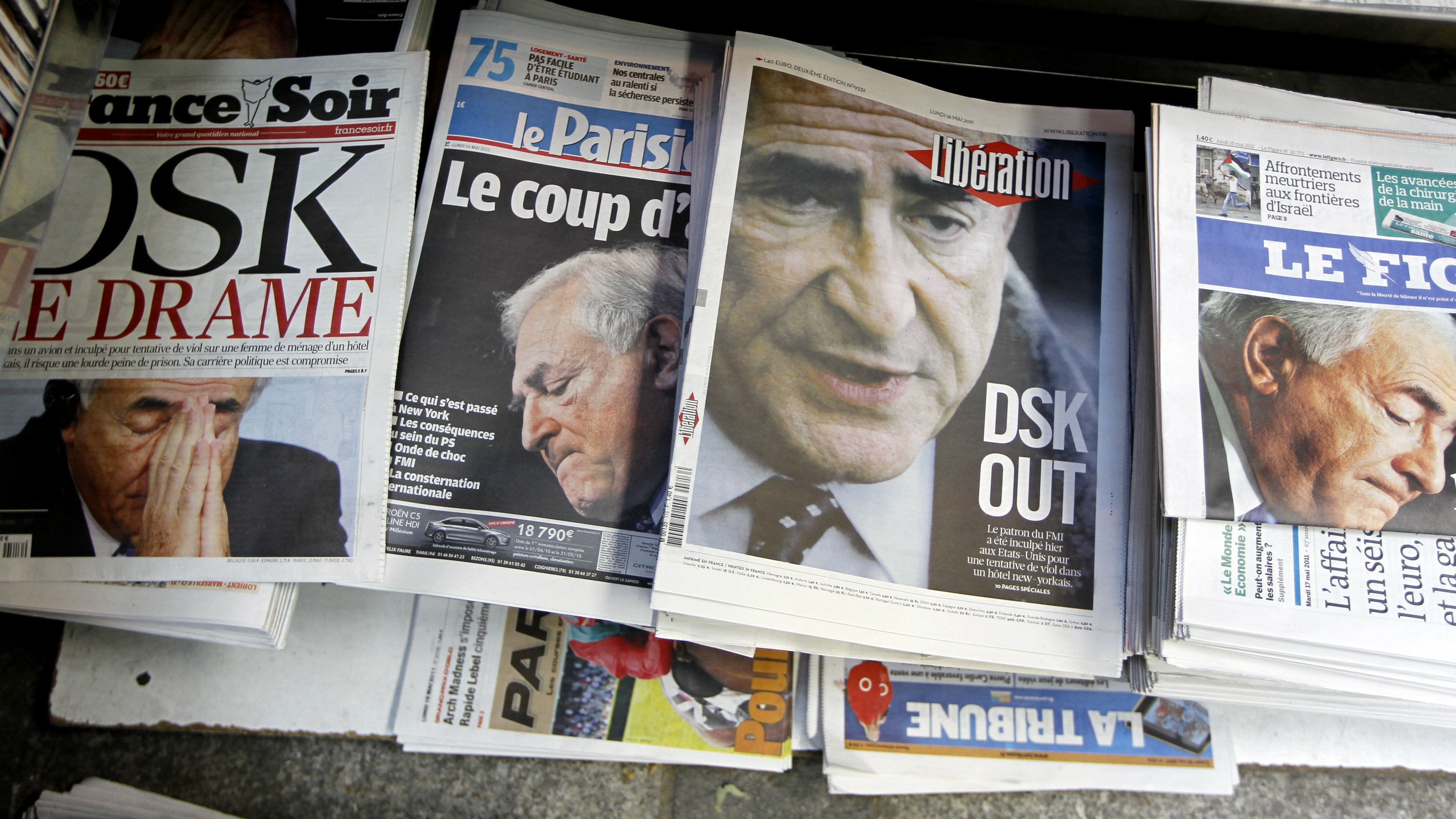 View of newspapers front pages about International Monetary Fund (IMF) chief Dominique Strauss-Kahn's arrest, at a central kiosk in Paris May 16, 2011. The arrest of IMF chief Dominique Strauss-Kahn on sexual assault charges has plunged France's Socialists into turmoil and thrown wide open the race for the presidency. REUTERS/Charles Platiau (FRANCE - Tags: POLITICS CRIME LAW)