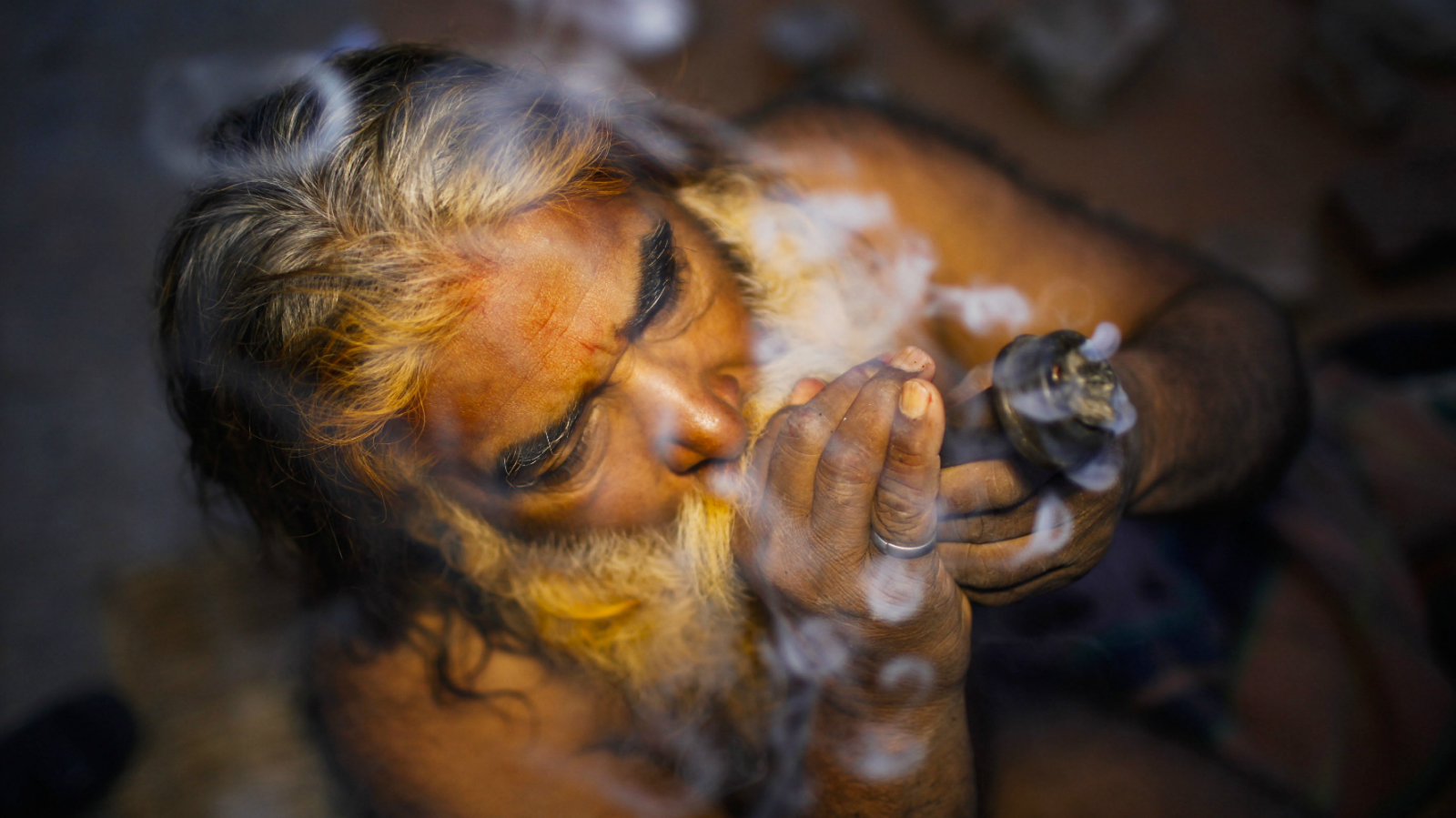 Sadhu (holy man) smokes marijuana from a clay pipe in an early morning at the premises of Pashupati Temple in Kathmandu, Nepal, 09 March 2013 on the eve of the Hindu's biggest festival Maha Shivaratri. More than 100,000 Hindu devotees including Sadhus from across the country and neighbouring India already gathered to celebrate the birthday of Lord Shiva, the god of creation and destruction. Hindus mark the Maha Shivratri festival by offering special prayers and fasting.