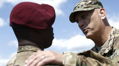 Army general instructing soldier during training