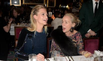 Poppy Delevingne and Lucinda Chambers attend the dinner, hosted by Olivier Rousteing, to mark the opening of Balmain's first London store, at Annabel's on March 16, 2015 in London, England. (Photo by David M. Benett/Getty Images for Balmain)