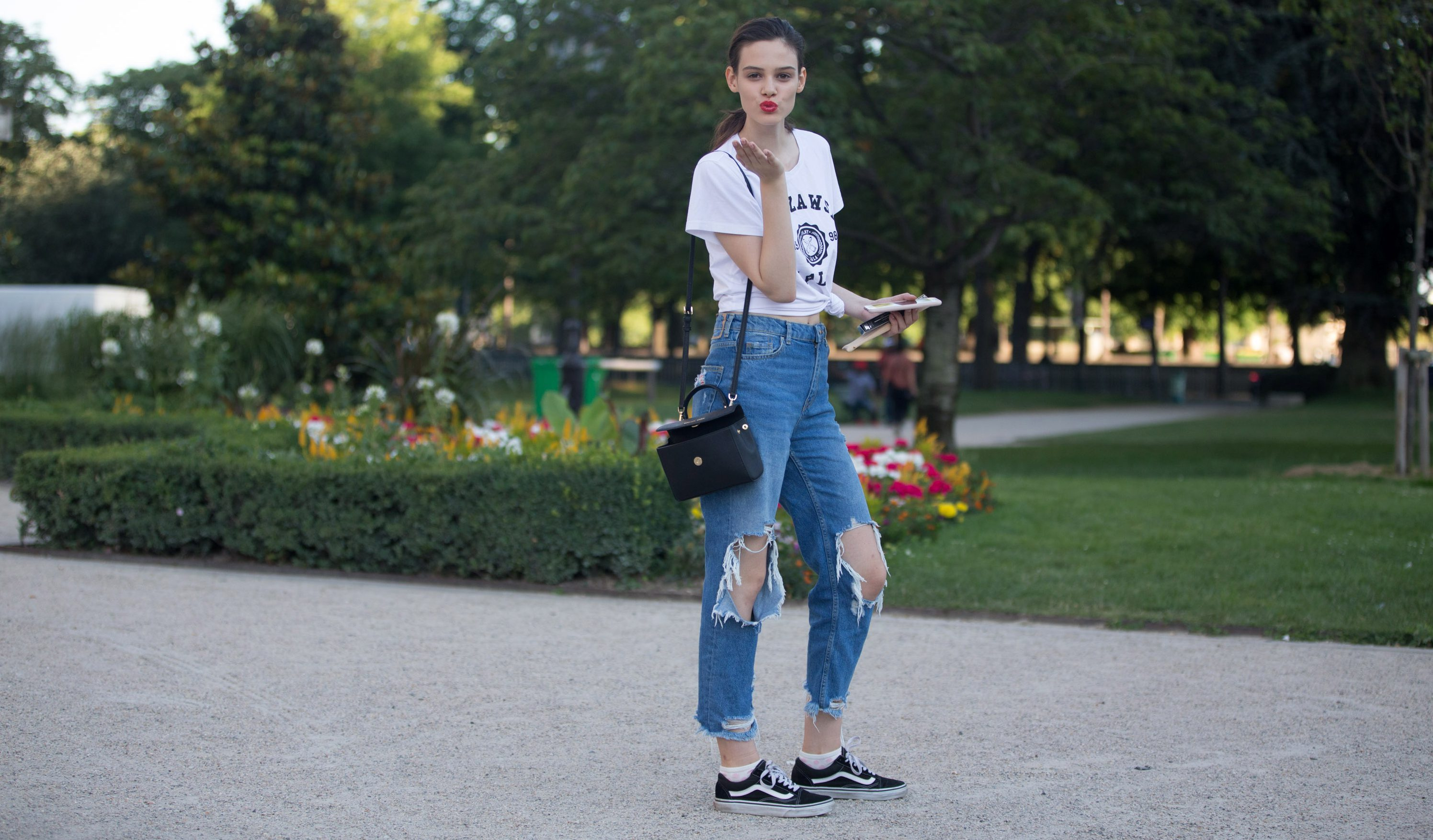 PARIS, FRANCE - JULY 03: Polish model Mag Cysewska wears a Warsaw shirt, black Vans sneakers, and blows a kiss outside the Giambattista Valli show on July 3, 2017 in Paris, France. (Photo by Melodie Jeng/Getty Images)