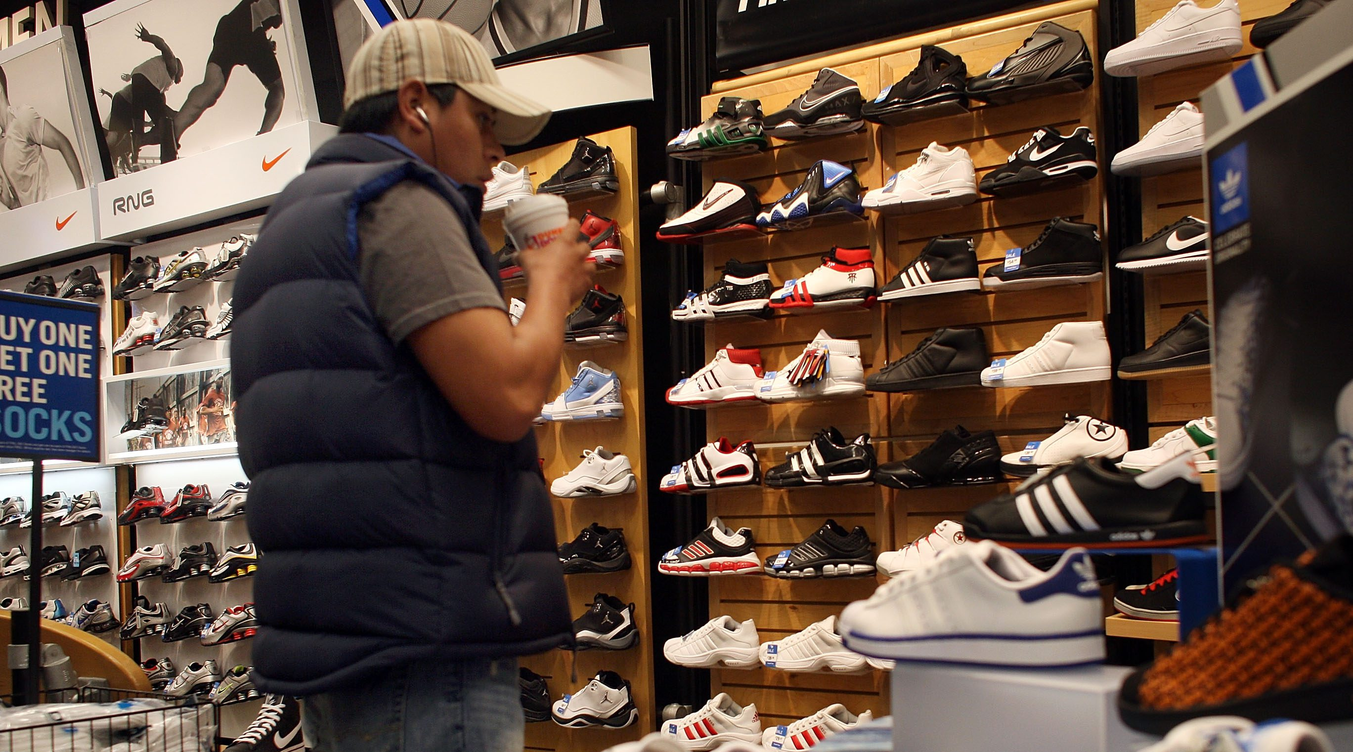 STAMFORD, CT - MARCH 27: A man shops for sneakers March 27, 2009 in Stamford, Connecticut. A government report released on Friday shows that consumer spending rose slightly for the second consecutive month in February. The Commerce Department said purchases advanced 0.2 percent in February after climbing 1 percent in January.  (Photo by Spencer Platt/Getty Images)